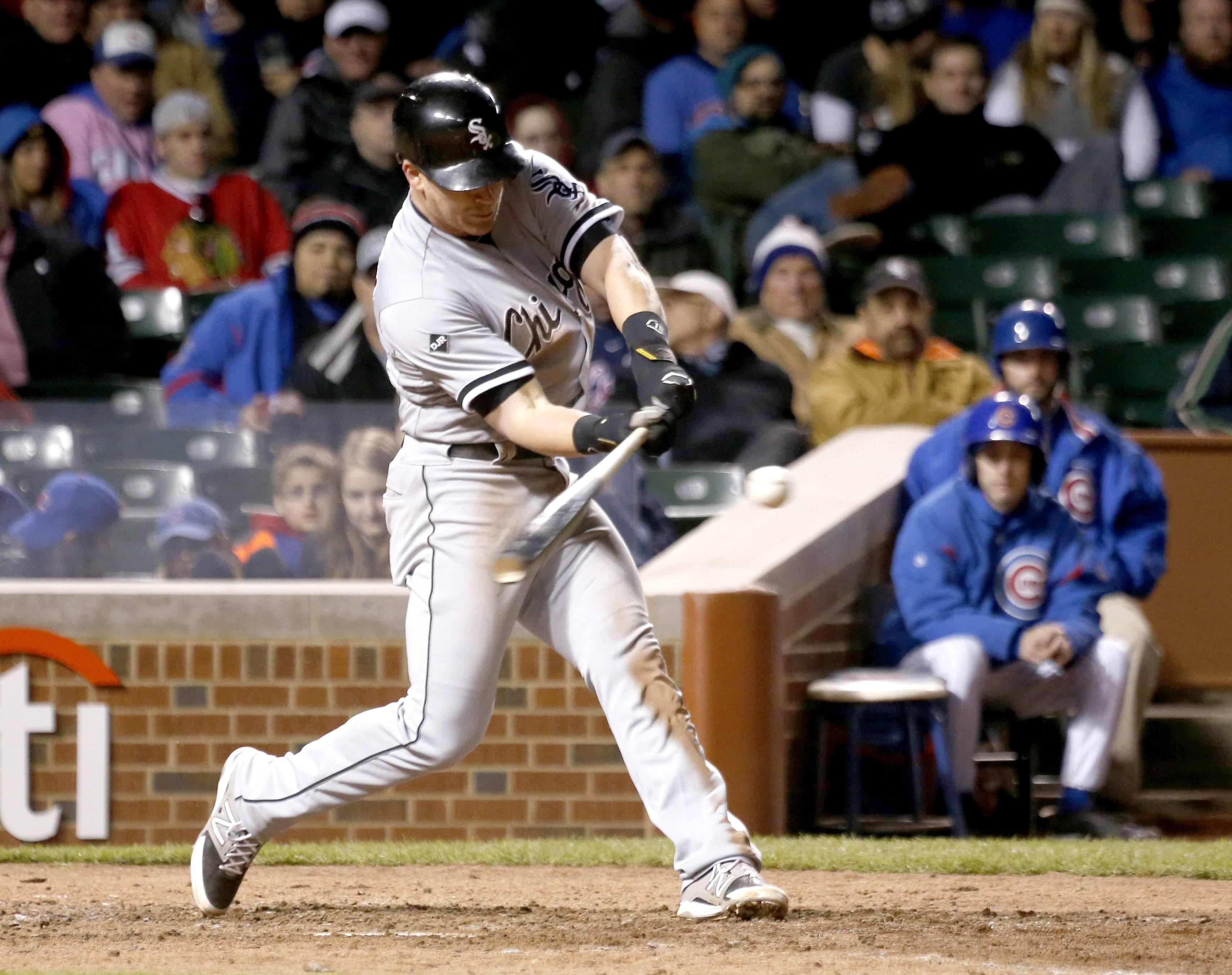 Chicago White Sox's Gordon Beckham launches a home run off Chicago Cubs relief pitcher Neil Ramirez during the eighth inning of an interleague baseball game Tuesday, May 6, 2014, in Chicago. (AP Photo/Charles Rex Arbogast)