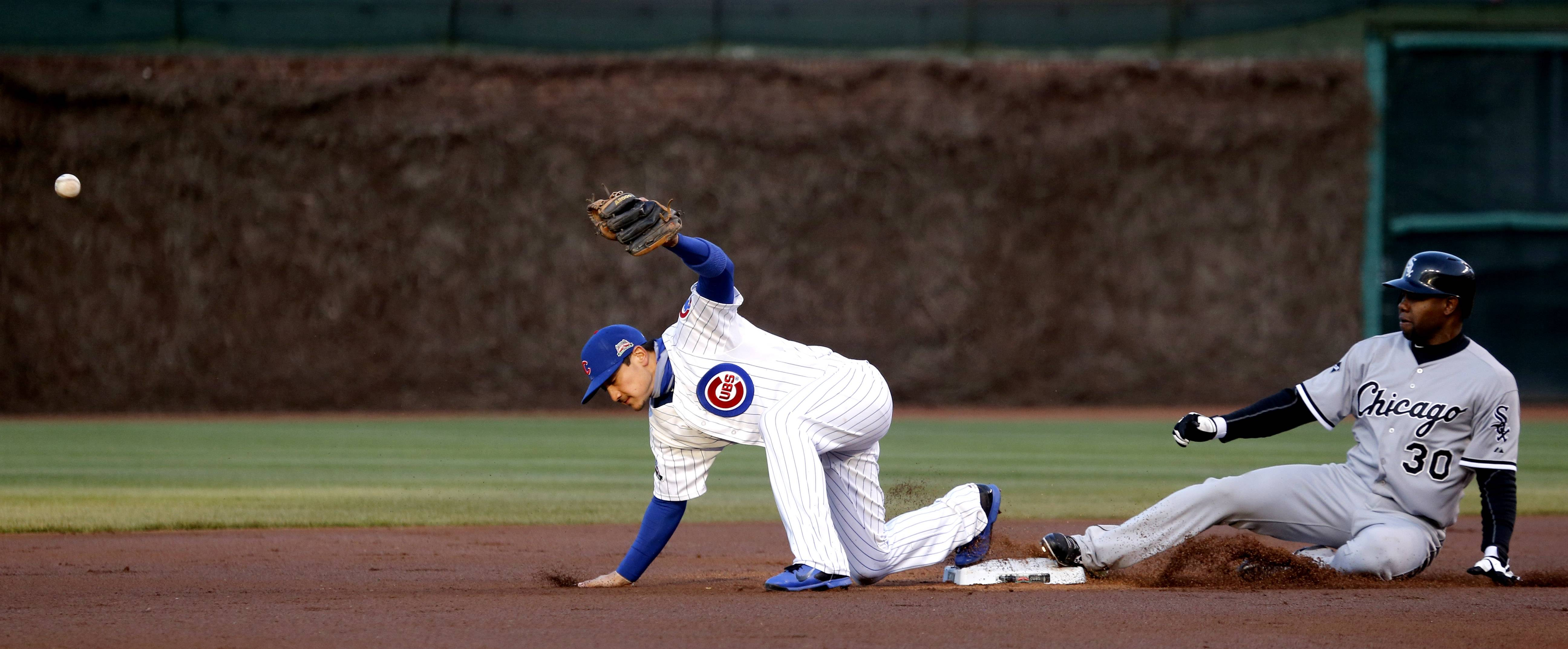 Chicago White Sox's Alejandro De Aza (30) slides safely into second as Chicago Cubs second baseman Darwin Barney is unable to handle a throw from third baseman Mike Olt, during the first inning of an interleague baseball game Monday, May 5, 2014, in Chicago. (AP Photo/Charles Rex Arbogast)