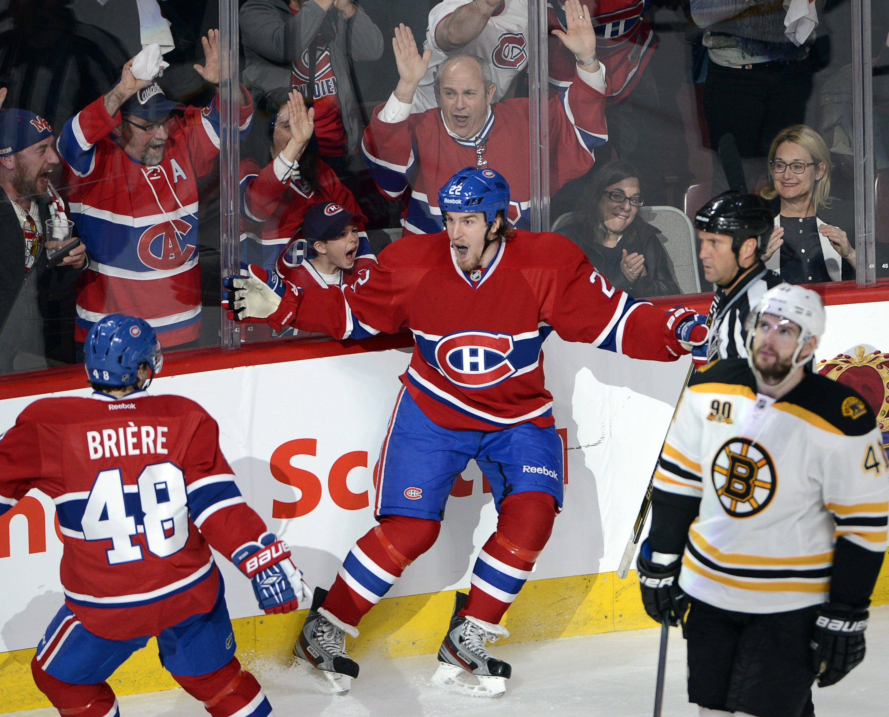 Montreal Canadiens right wing Dale Weise (22) celebrates his goal with teammate center Daniel Briere (48) as Boston Bruins defenseman Andrej Meszaros (41) looks on during the second period of Game 3 of an NHL hockey Stanley Cup playoff series, Tuesday, May 6, 2014, in Montreal. (AP Photo/The Canadian Press, Ryan Remiorz)