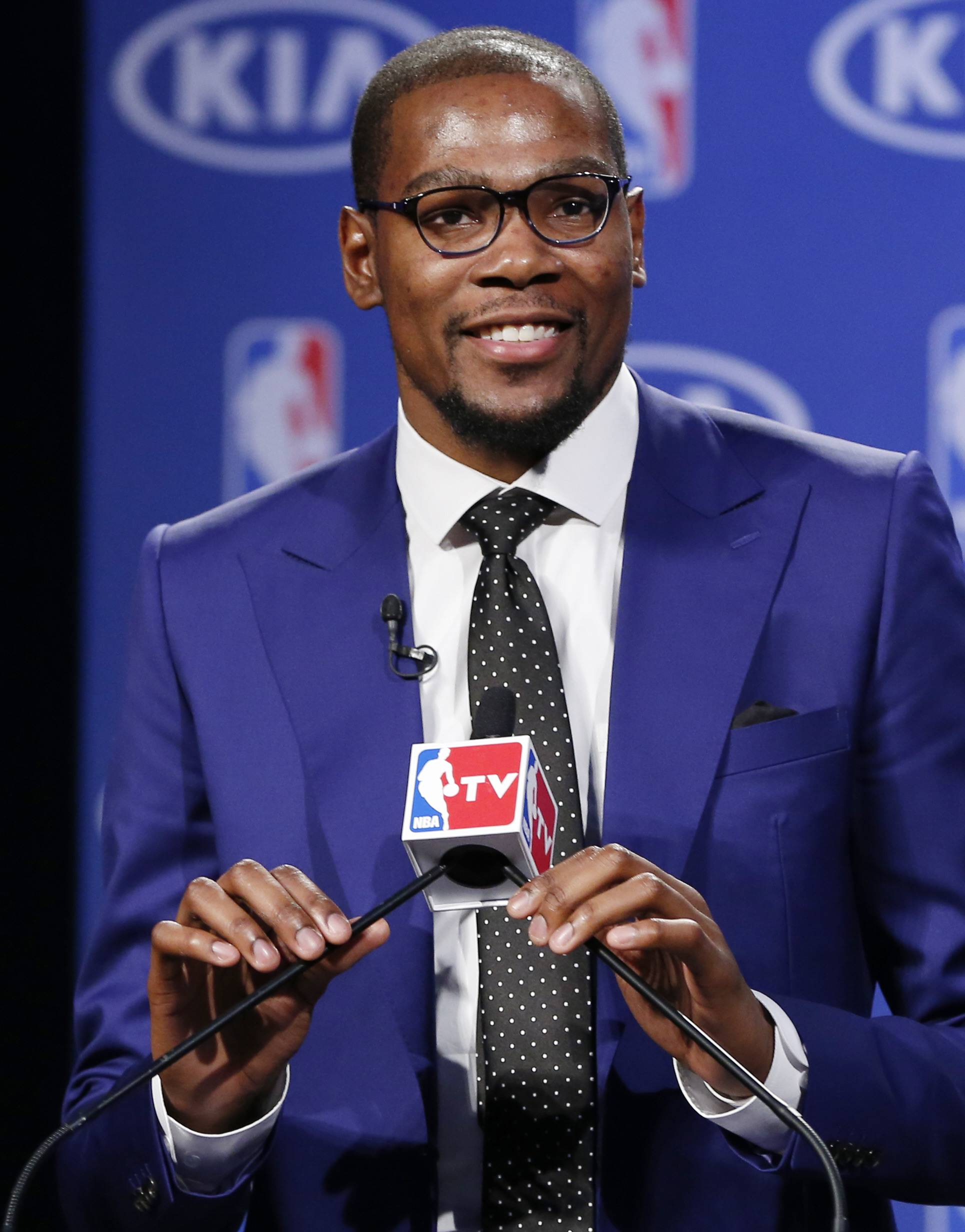 Oklahoma City Thunder's Kevin Durant speaks at the news conference announcing that that Durant is the winner of the 2013-14 Kia NBA Basketball Most Value Player Award in Oklahoma City, Tuesday, May 6, 2014. (AP Photo/Sue Ogrocki)