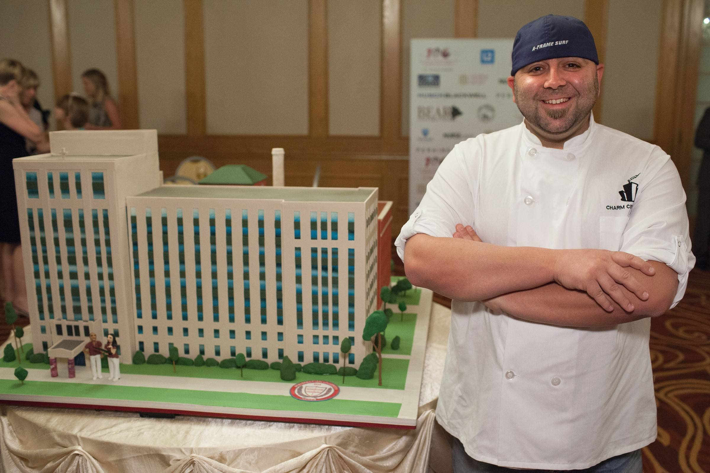 Resurrection University celebrated the 100th anniversary of its College of Nursing with edible replicas of the school's original Oak Park facility and its new school in Chicago's Wicker Park neighborhood created by chef Duff Goldman of Charm City Cakes in Baltimore, Md.