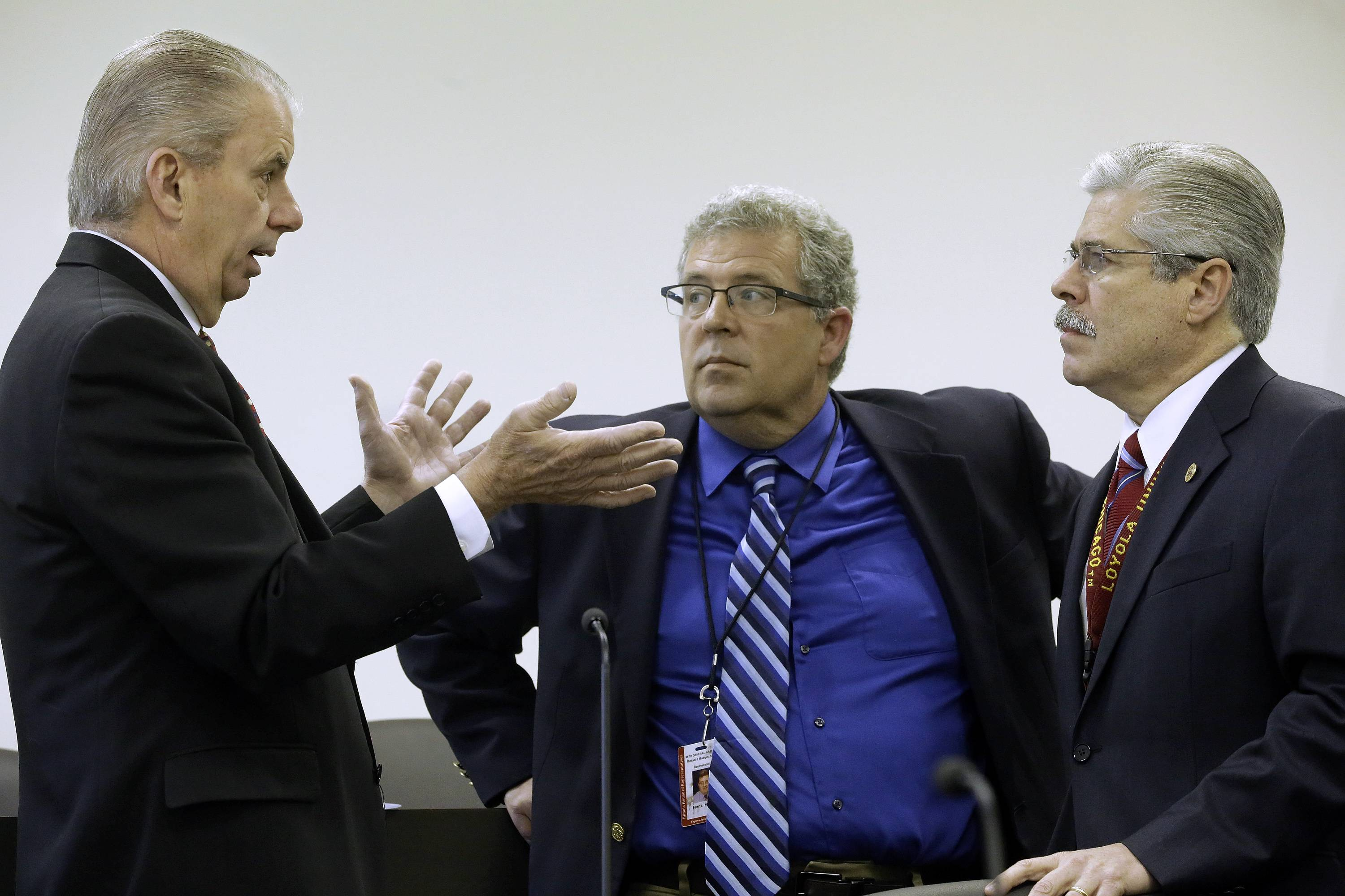 Illinois Auditor General William Holland, left, Illinois Rep. Frank J. Mautino, a Spring Valley Democrat, center, and Illinois Rep. Fred Crespo, a Hoffman Estates Democrat, right, talk at the state Capitol on Tuesday, May 6, 2014, in Springfield, Ill., during a legislative commission that helps review the use of public money and voted to grant itself subpoena powers to investigate Illinois Gov. Pat Quinn's troubled anti-violence program. The Legislative Audit Commission voted in favor of the Republican state Sen. Jason Barickman's motion by a 10-1 vote.