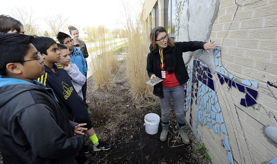 Anna Soltys helps brings public art to neighborhoods across Chicago, and now, Palatine. She worked with students Tuesday creating a mural on the side of Jane Addams Elementary School.