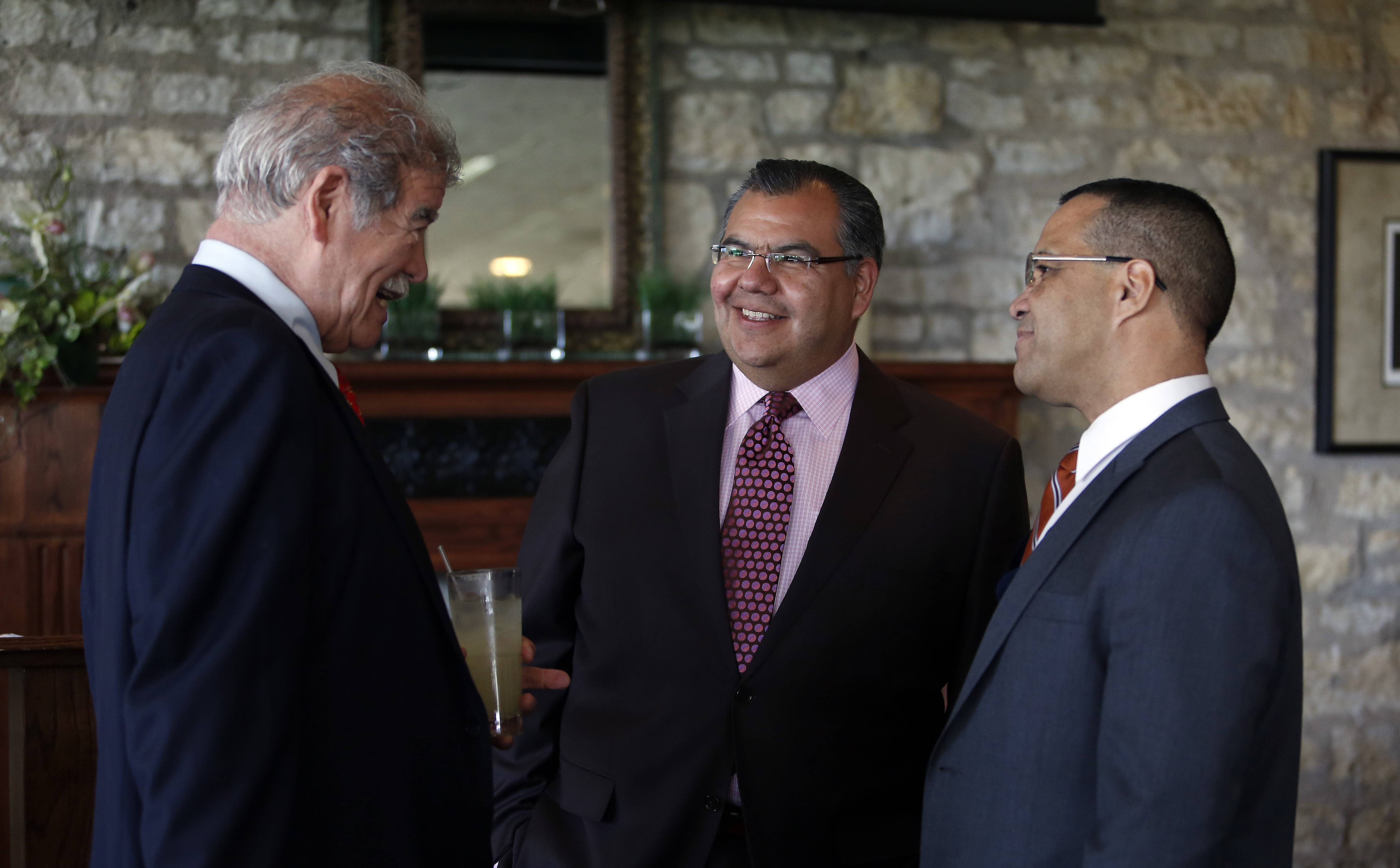 Martin Castro, center, chairman of the U.S. Commission on Civil Rights, was the guest speaker Tuesday at the annual Community Day luncheon benefiting Centro de Informacion at the Elgin Country Club. Castro talks to retired federal judge Manuel Barbosa, left, and Elgin Area School District U-46 Superintendent Jose Torres.