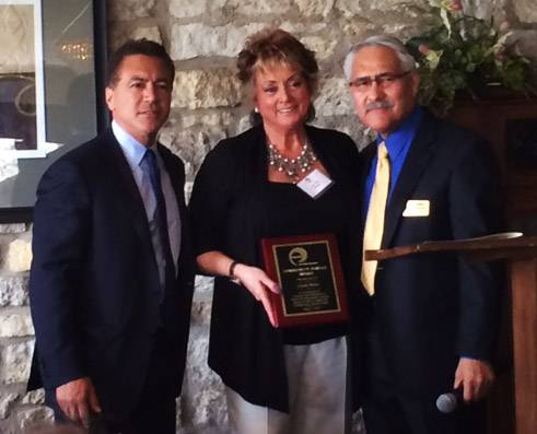 Linda Siete, center, manager of sales and operations for Reflejos bilingual newspaper, received an award as a supporter of Centro de Informacion during the Elgin-based nonprofit's annual Community Day luncheon Tuesday. On the left is Kent Lucaccioni, Centro's board president, and Jaime Garcia, Centro's executive director.