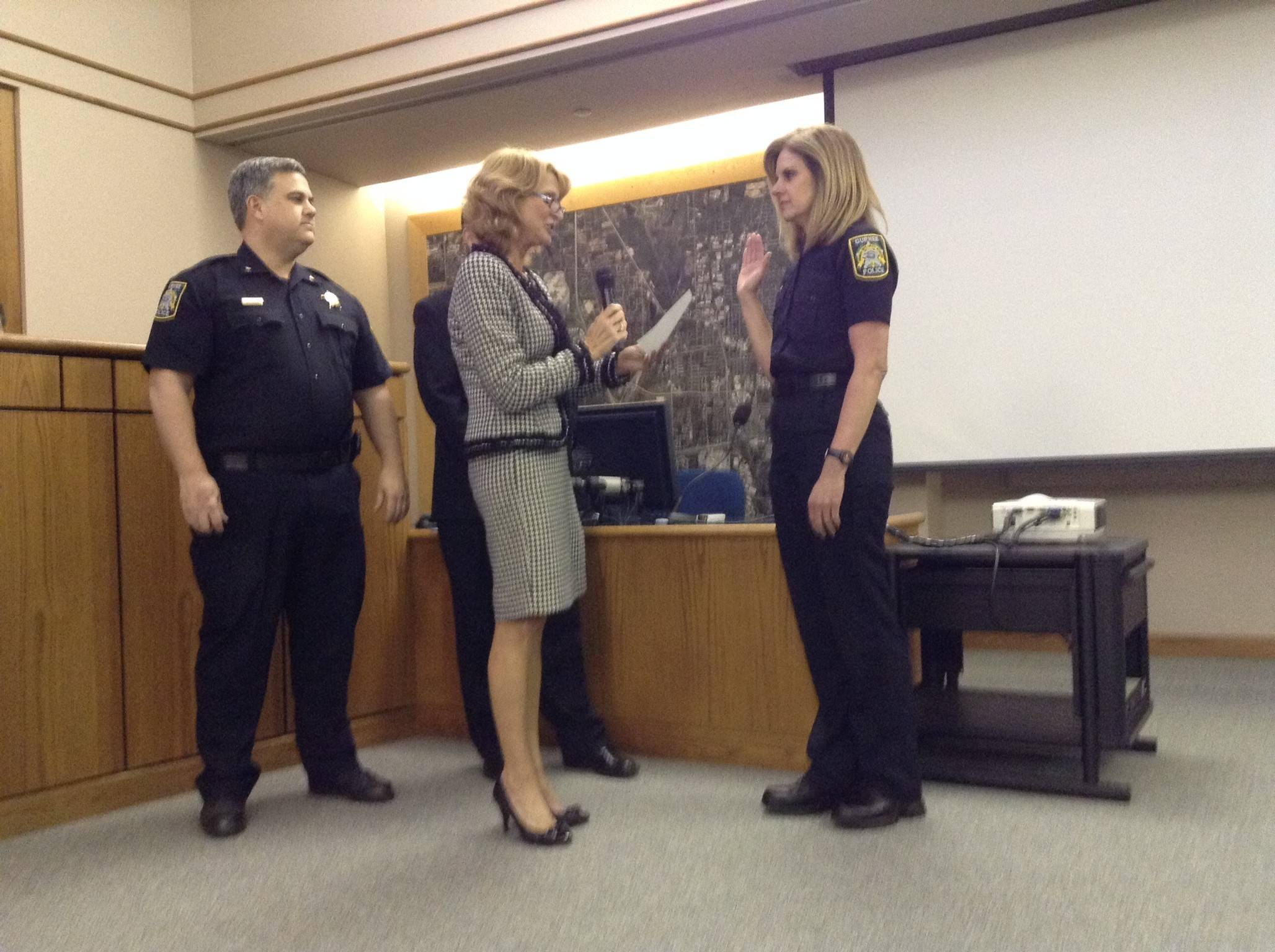 Gurnee Mayor Kristina Kovarik swears in Saundra Campbell as deputy police chief at Monday's village board meeting. Campbell was promoted from commander to deputy chief.
