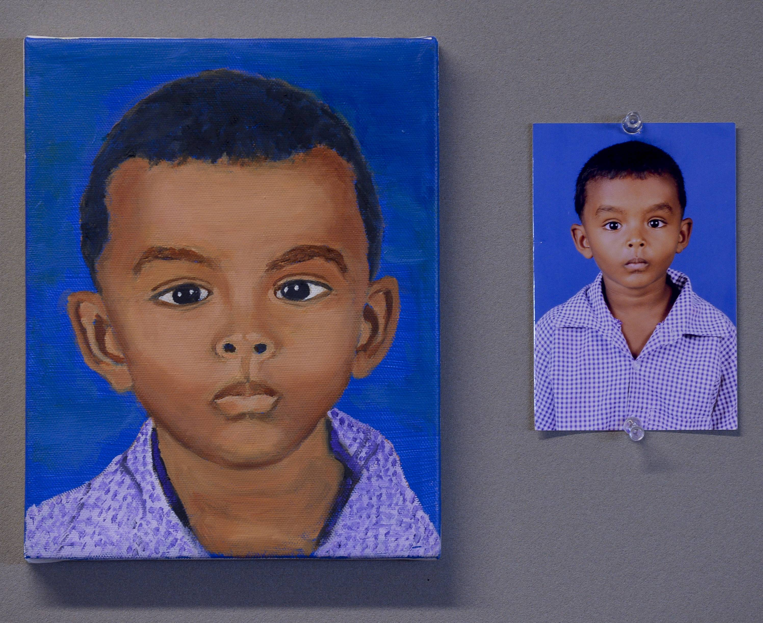 A portrait and the source photograph of a Sri Lankan child. Each portrait shows a child against a blue background and wearing a checkered school uniform, yet each picture shows the student painter's individual style, says Jennifer Hereth, the art professor that led the project.