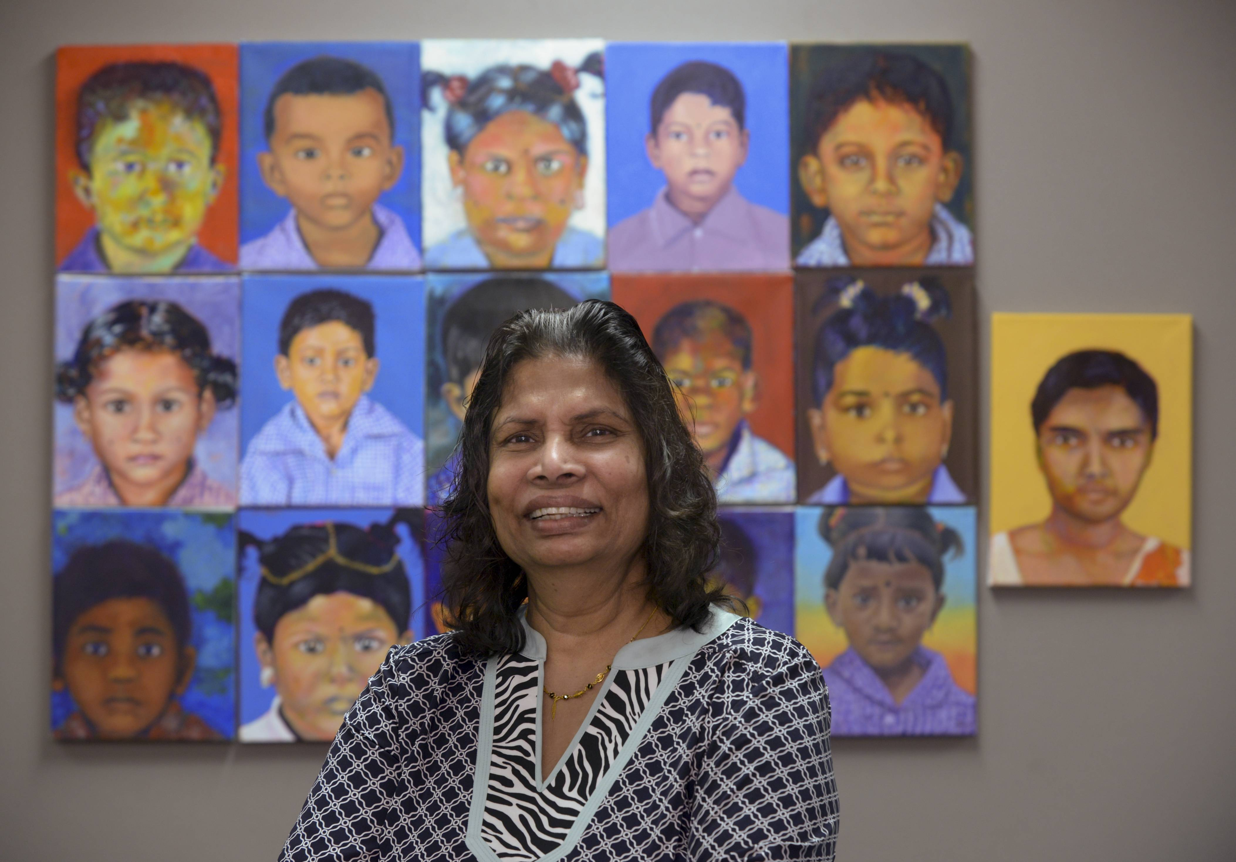 COD art student Evangeline Alagaratnam visited her native Sri Lanka two years ago and found children struggling to go school in that war-torn country. She took photos of the children that inspired art professor Jennifer Hereth to have her art students paint portraits of the children.