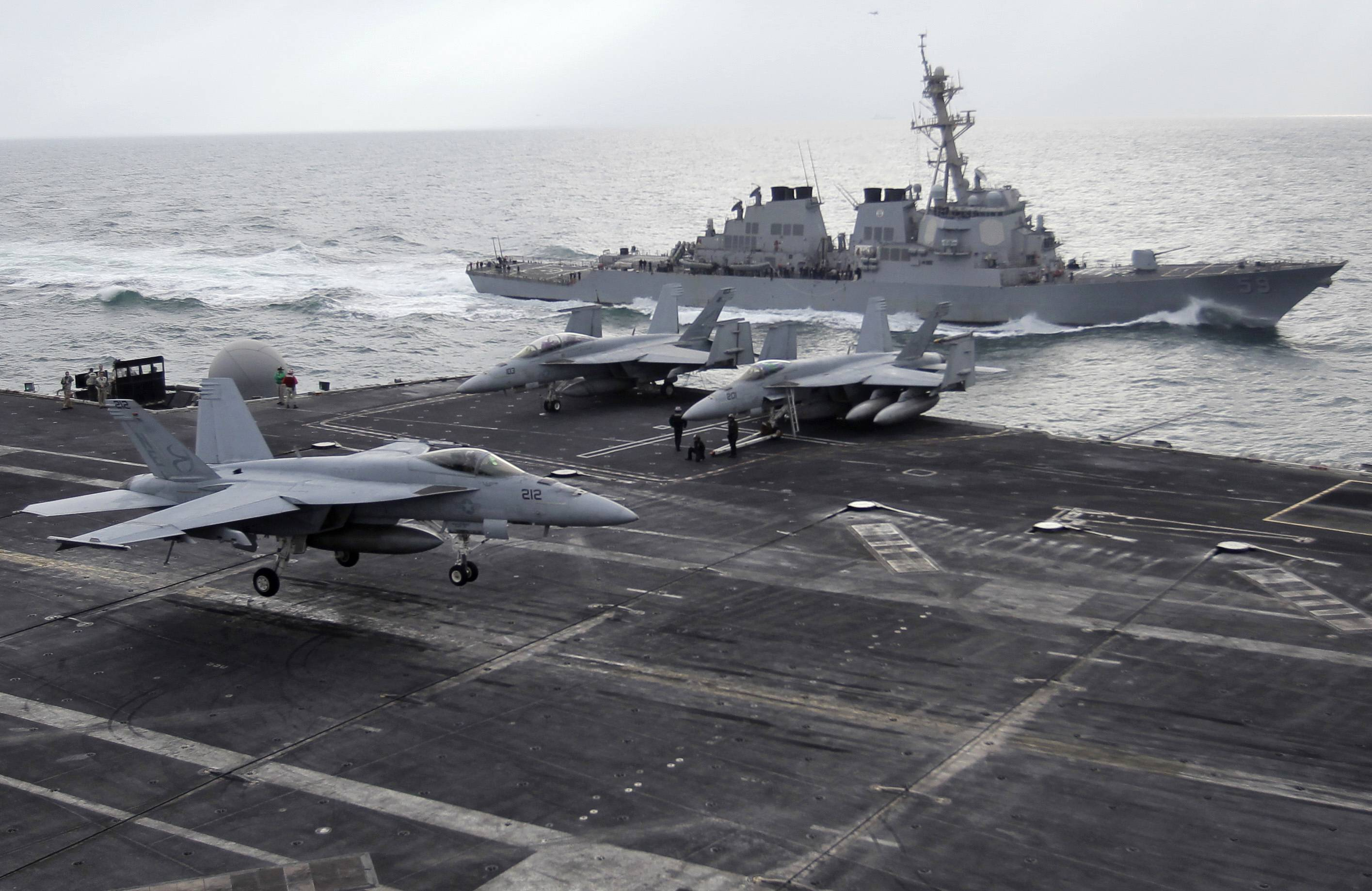 Iran will target American aircraft carriers in the Persian Gulf should a war between the two countries ever break out, the naval chief of Iran's powerful Revolutionary Guard warned Tuesday as the country completes work on a large-scale mock-up of a U.S. carrier.