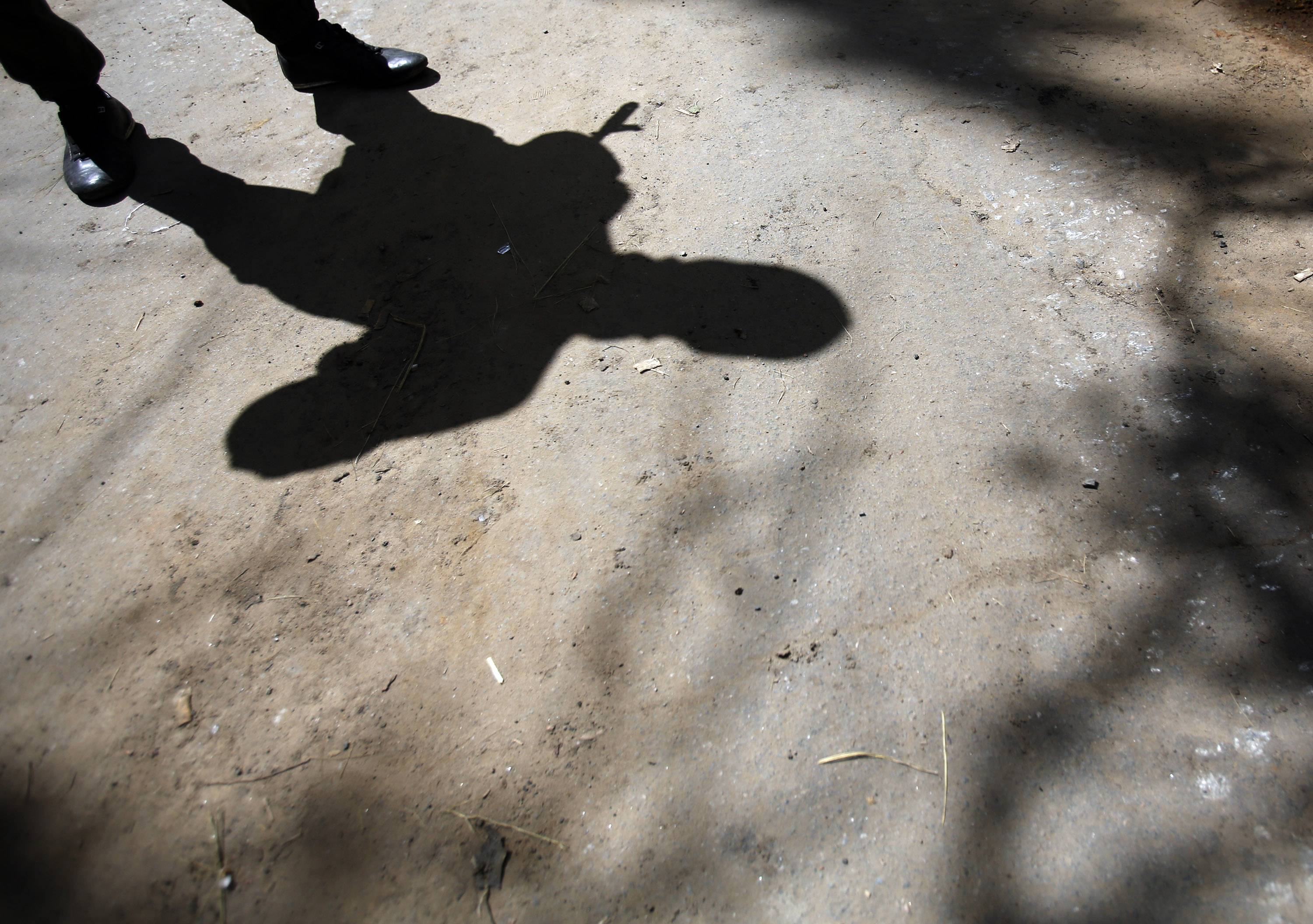 The shadow of an armed pro-Russian man while guarding the local administration building in the center of Slovyansk, eastern Ukraine, Tuesday.