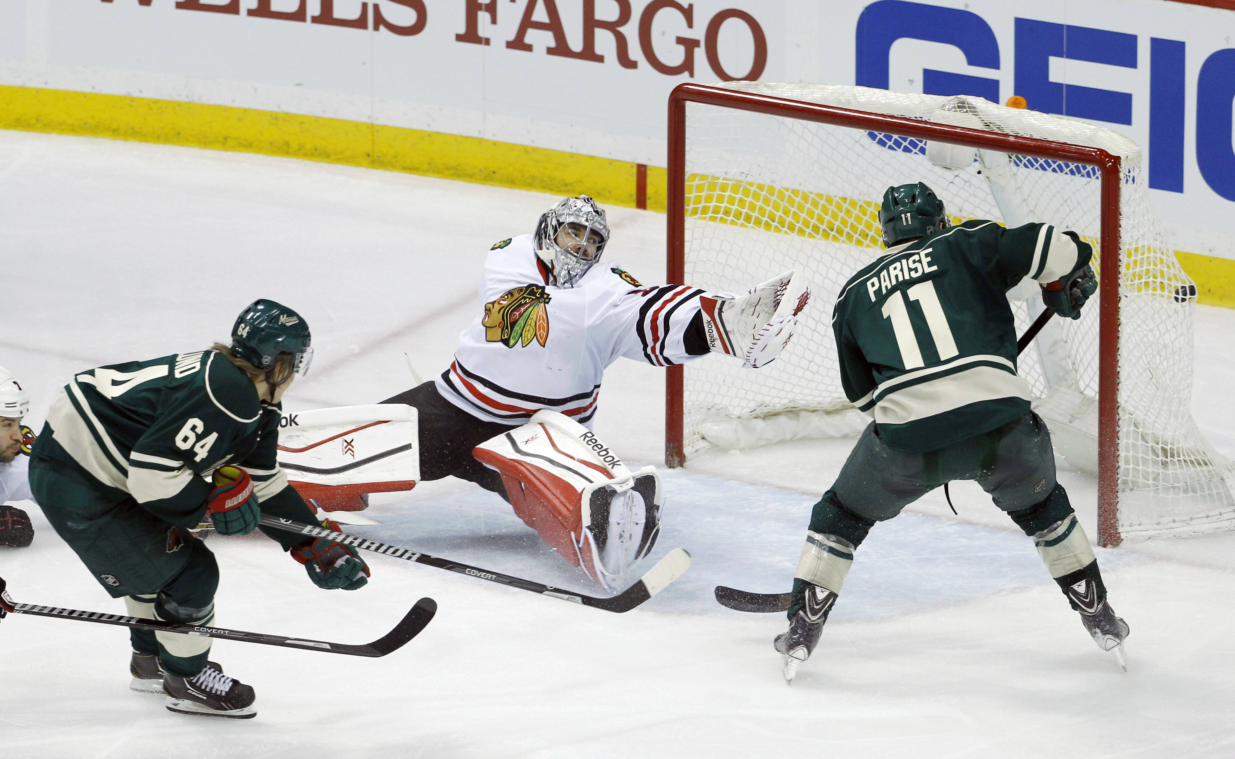 A shot by Minnesota Wild center Mikael Granlund (64 gets past Blackhawks goalie Corey Crawford and Wild left wing Zach Parise (11) during the third period of Game 3 Tuesday in St. Paul, Minn. The Wild won 4-0.