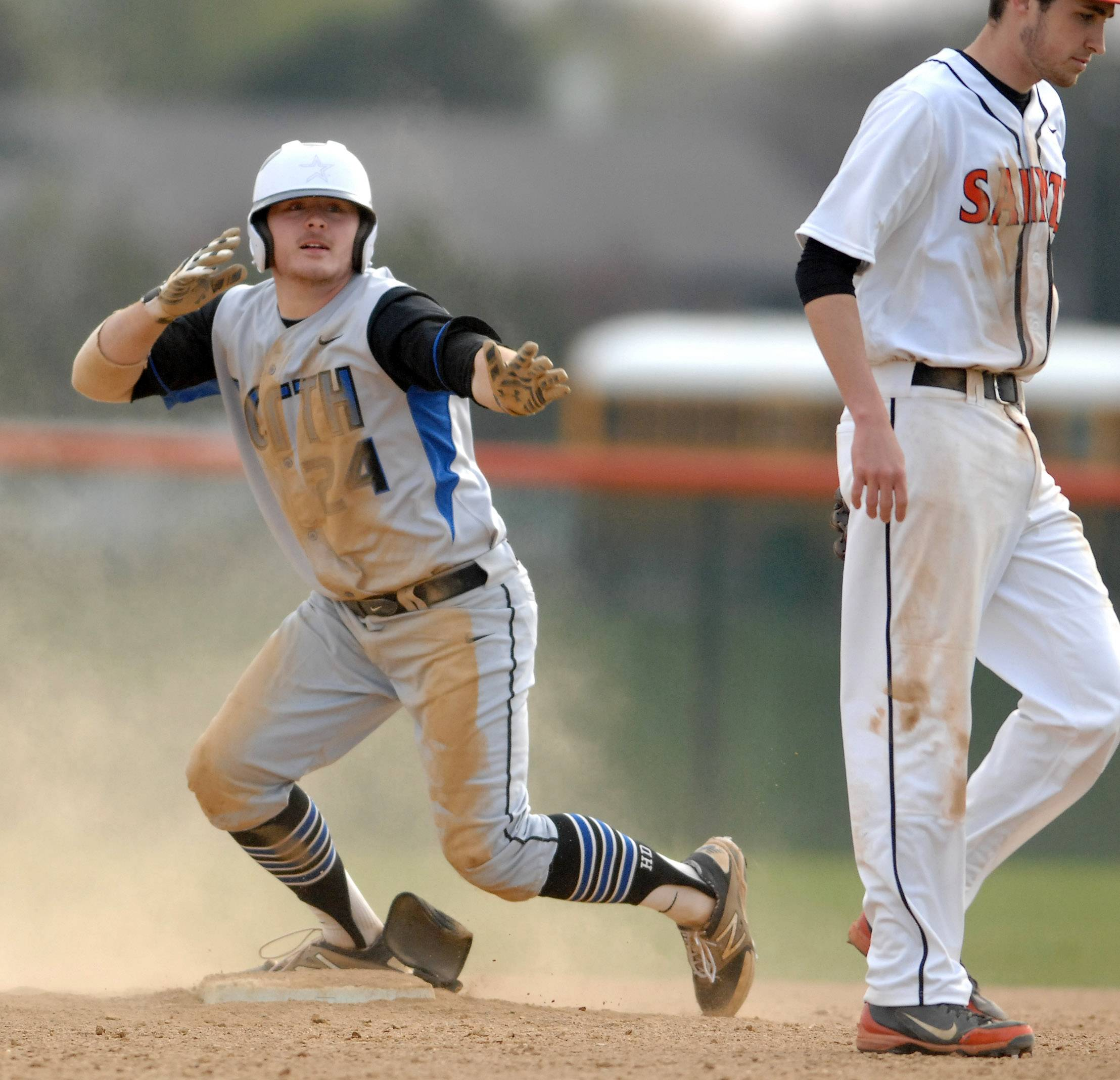 St. Charles North's Jack Dennis looks to his dugout as they celebrate his RBI double during Tuesday's game.