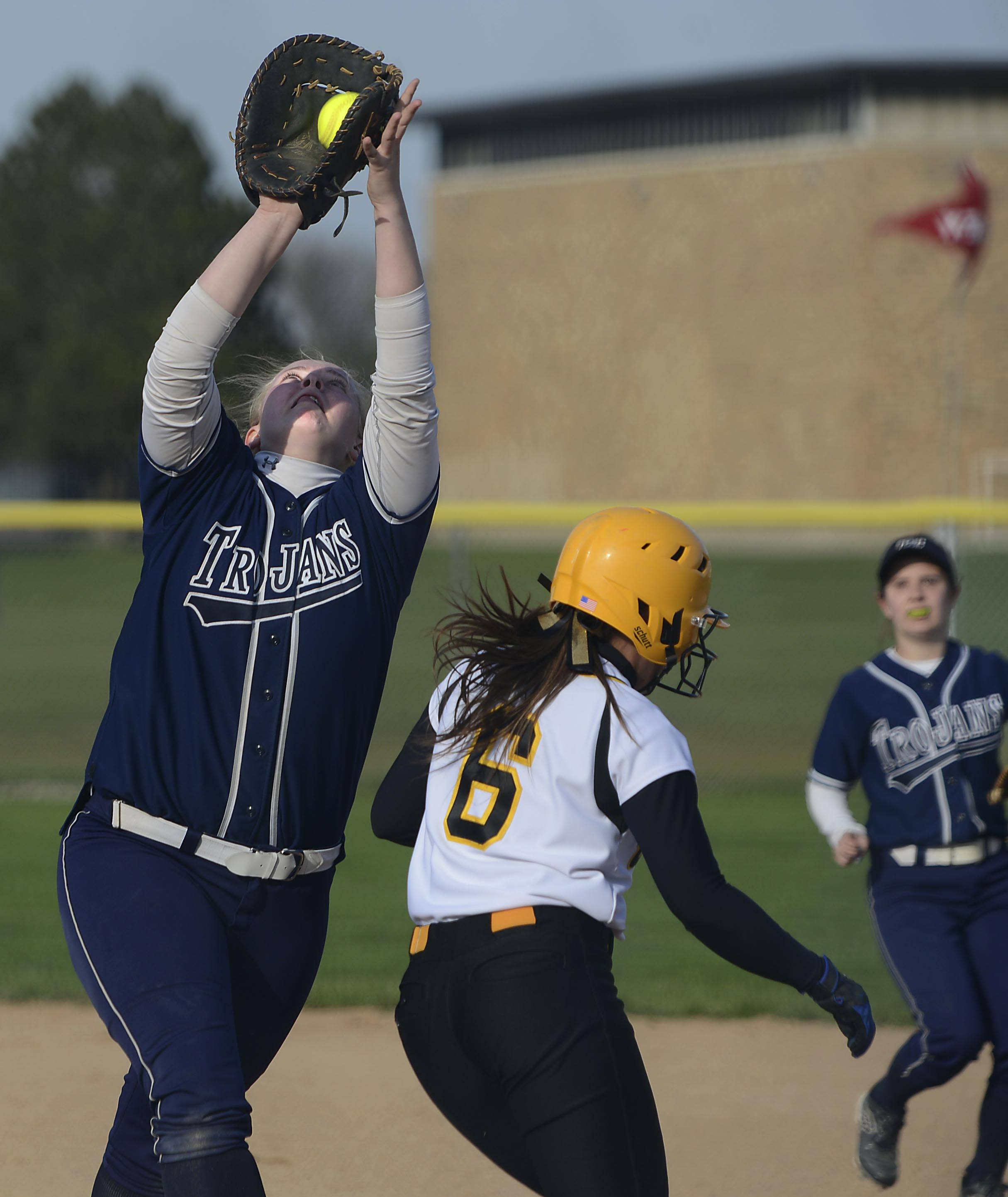 Cary-Grove first baseman Brianne Prank catches a pop up by Jacobs' Danielle O'Toole in the fourth inning Tuesday in Cary.