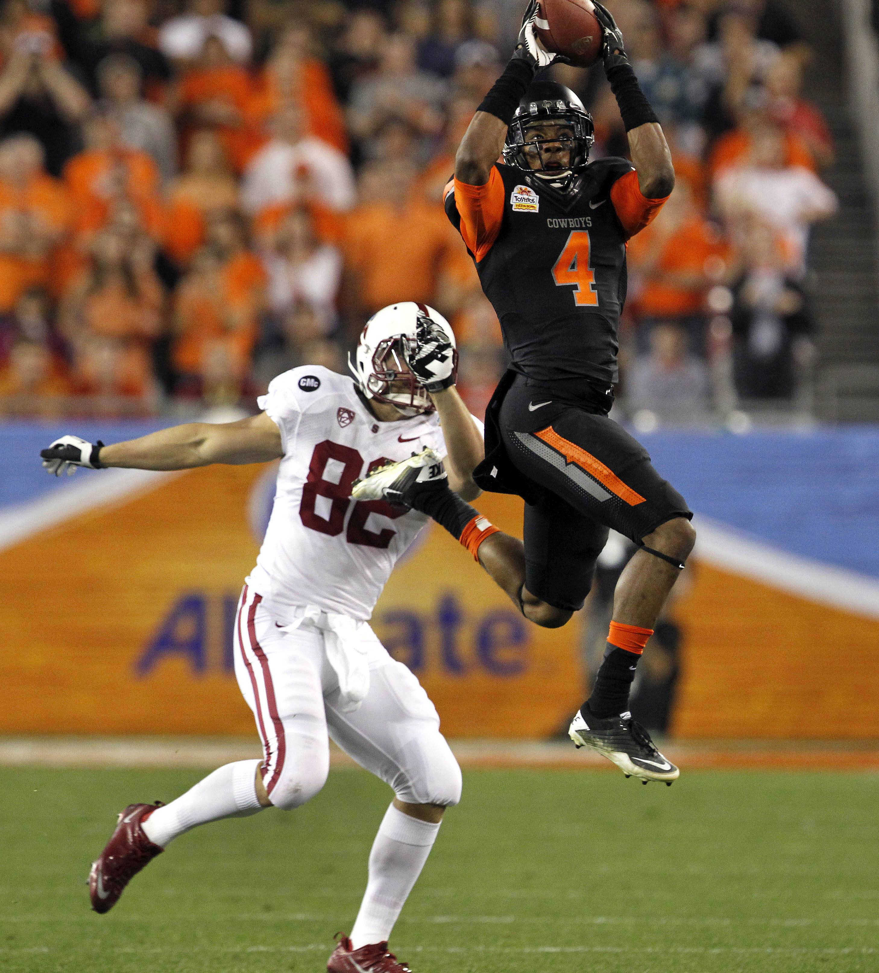 Oklahoma State cornerback Justin Gilbert, here interecepting a pass in the Fiesta Bowl is a top prospect in the NFL draft. He fnished his collegiate career with 12 interceptions.
