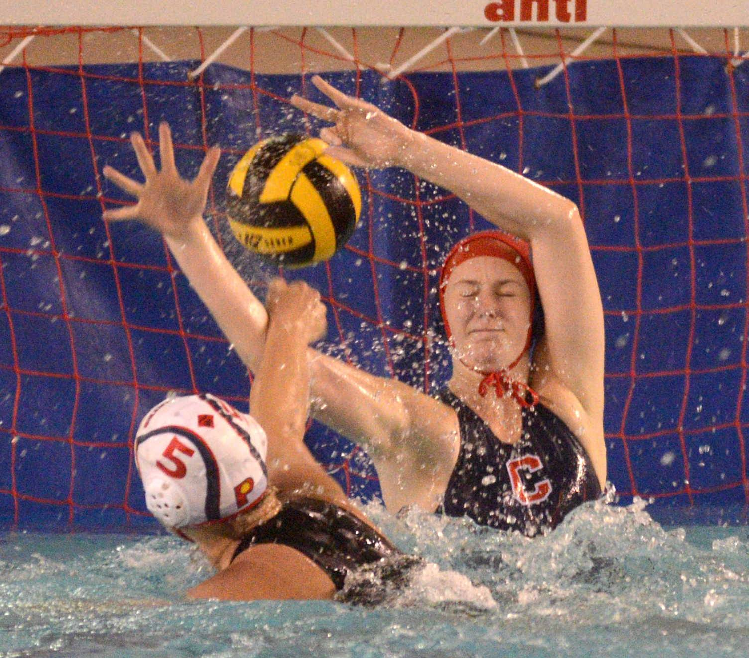 Conant's goalie Maddy Demaret blocks a shot by Palatine's Rachel Chumbook during Monday's match.