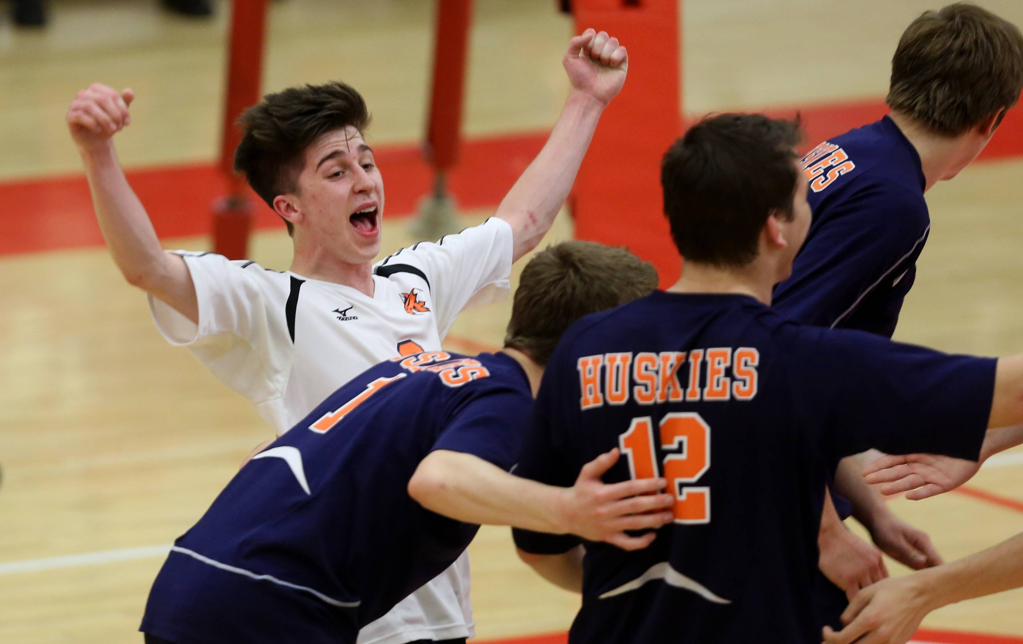 Naperville North's Will Littell celebrates a point against Naperville Central.