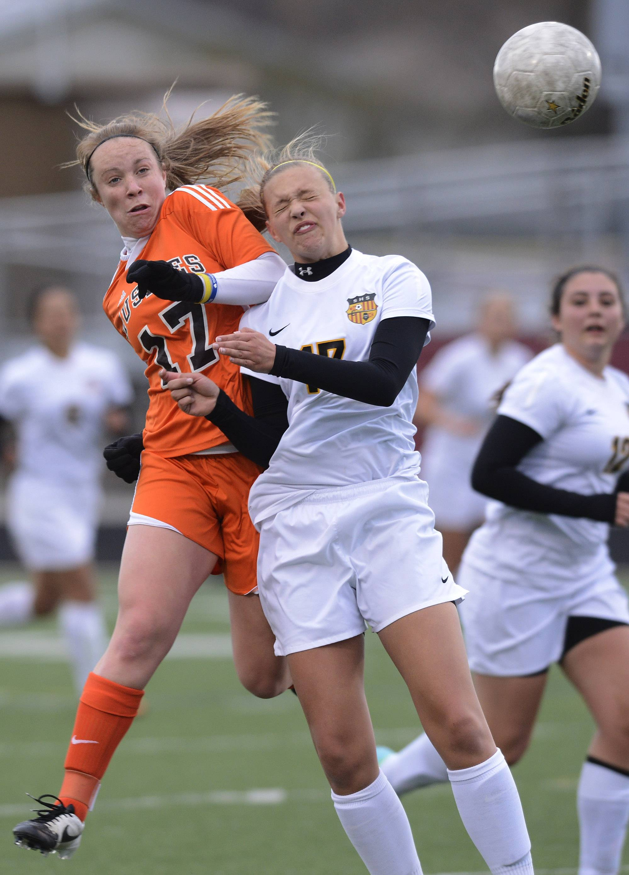 Hersey's Lauren Gierman, left, and Schaumburg's Kennedy Irmen leap for a header during Wednesday's game at Schaumburg.