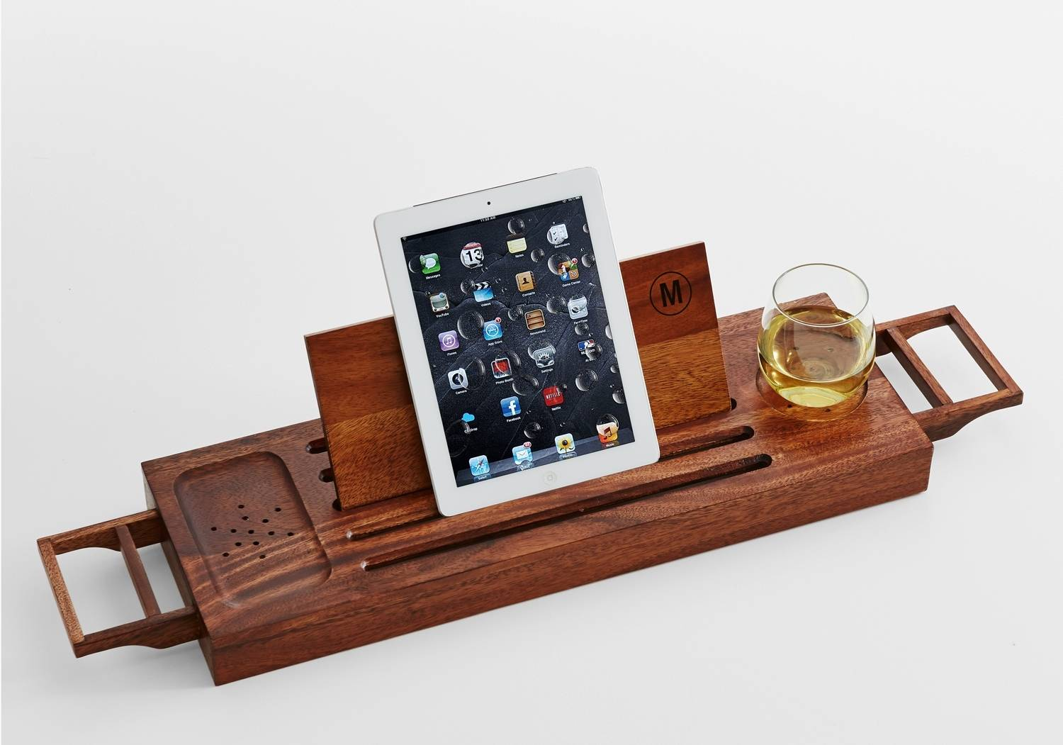 "A monogrammed acacia wood bath caddy, with space for a beverage, phone and e-reader or book, would be a thoughtful gift for moms who enjoy ""me"" time in the bathtub."