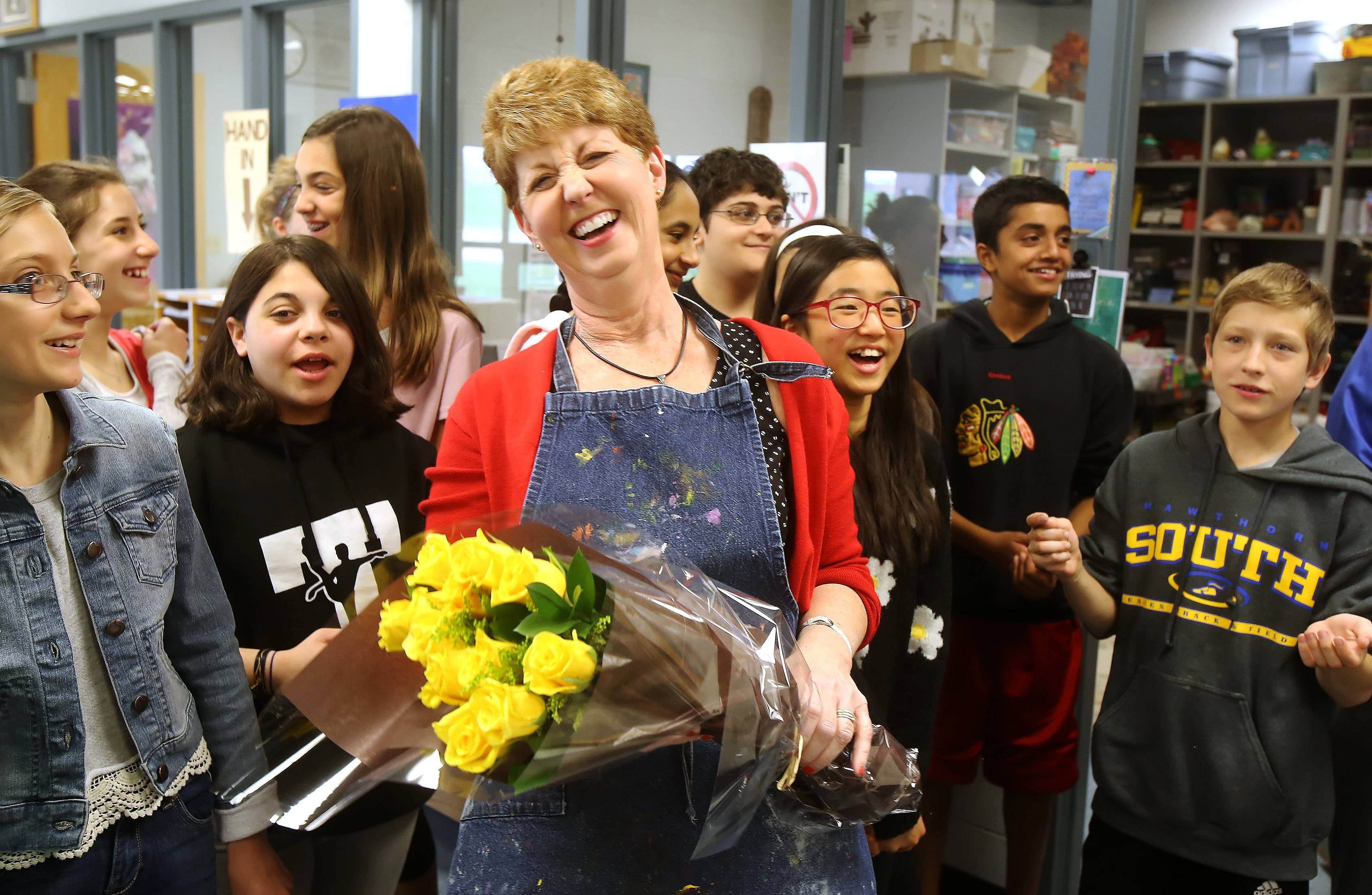 Hawthorn Middle School South art instructor Mary Benton is surprised Wednesday morning when she learns she's received the prestigious Golden Apple Award for Excellence in Teaching during a presentation at the Vernon Hills school. She was the only teacher in Lake County to receive the award.