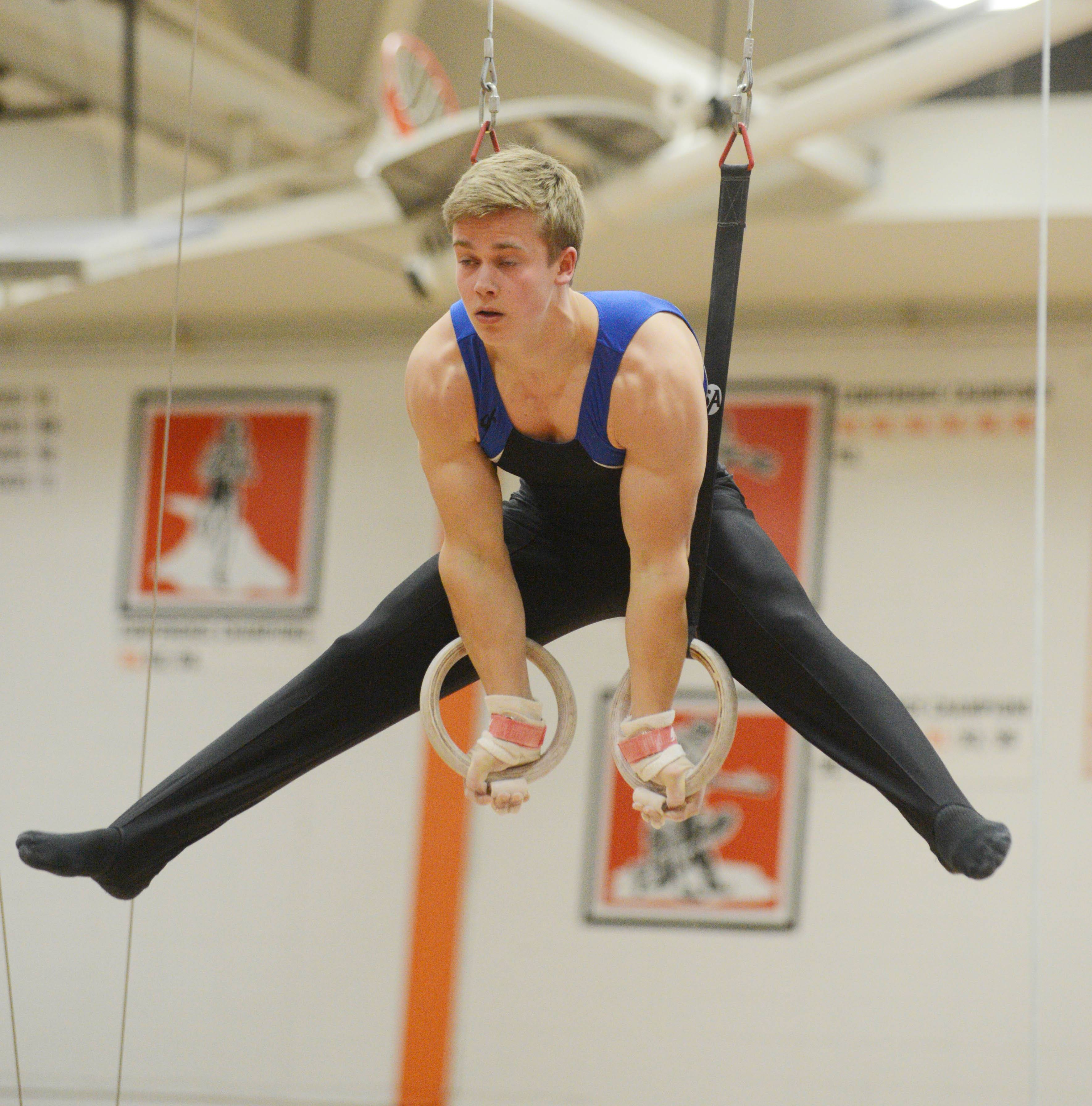 Paul Michna/pmichna@dailyherald.comConnor Ritchie of Wheaton Warrenville South on the rings during the Wheaton Warrenville South boys gymnastics sectional Wednesday.