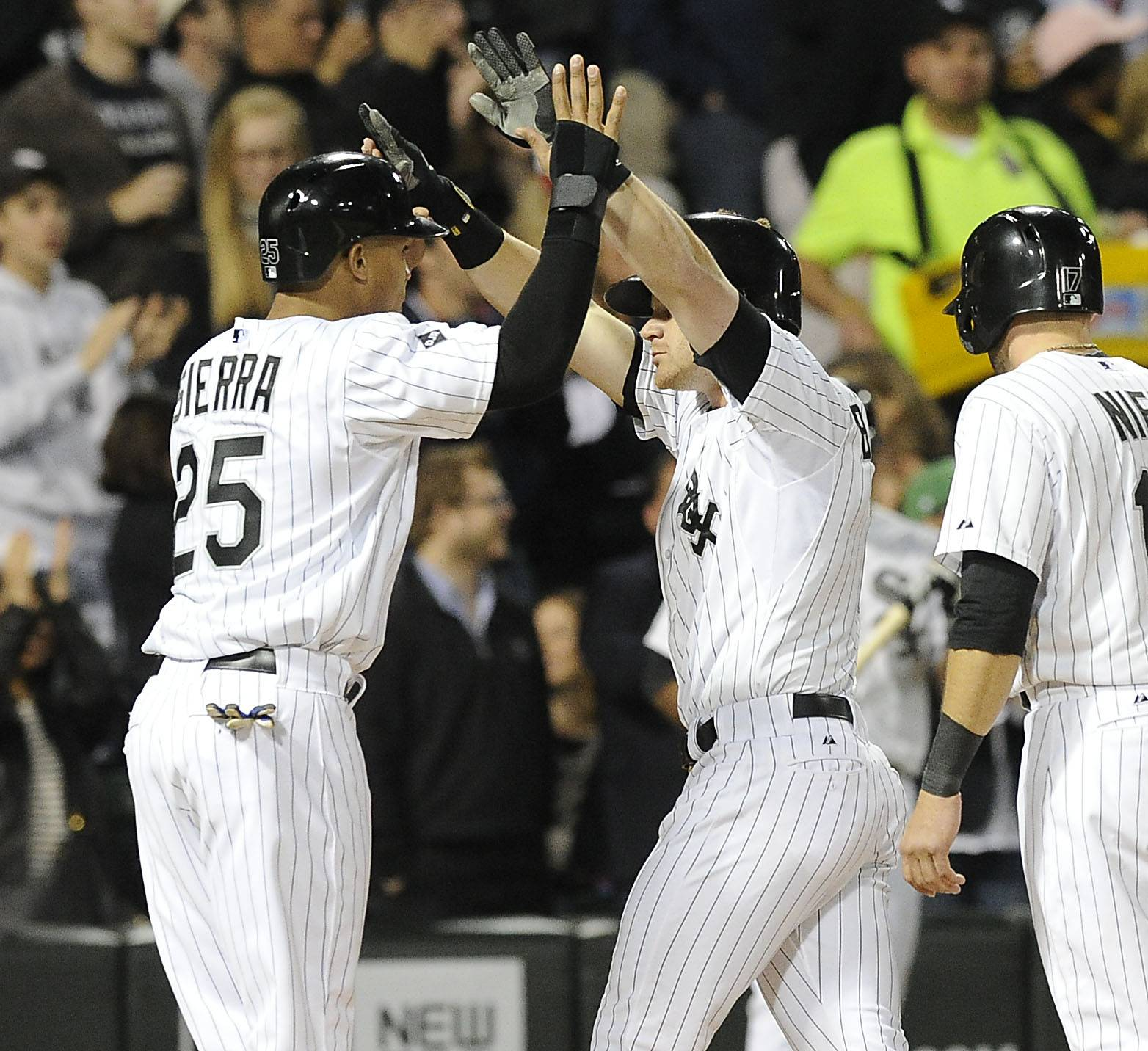 Mark Welsh/mwelsh@dailyherald.com Chicago White Sox's Gordon Beckham greets Moises Sierra at home plate after his three run homer in the fourth inning of the Crosstown Classic.