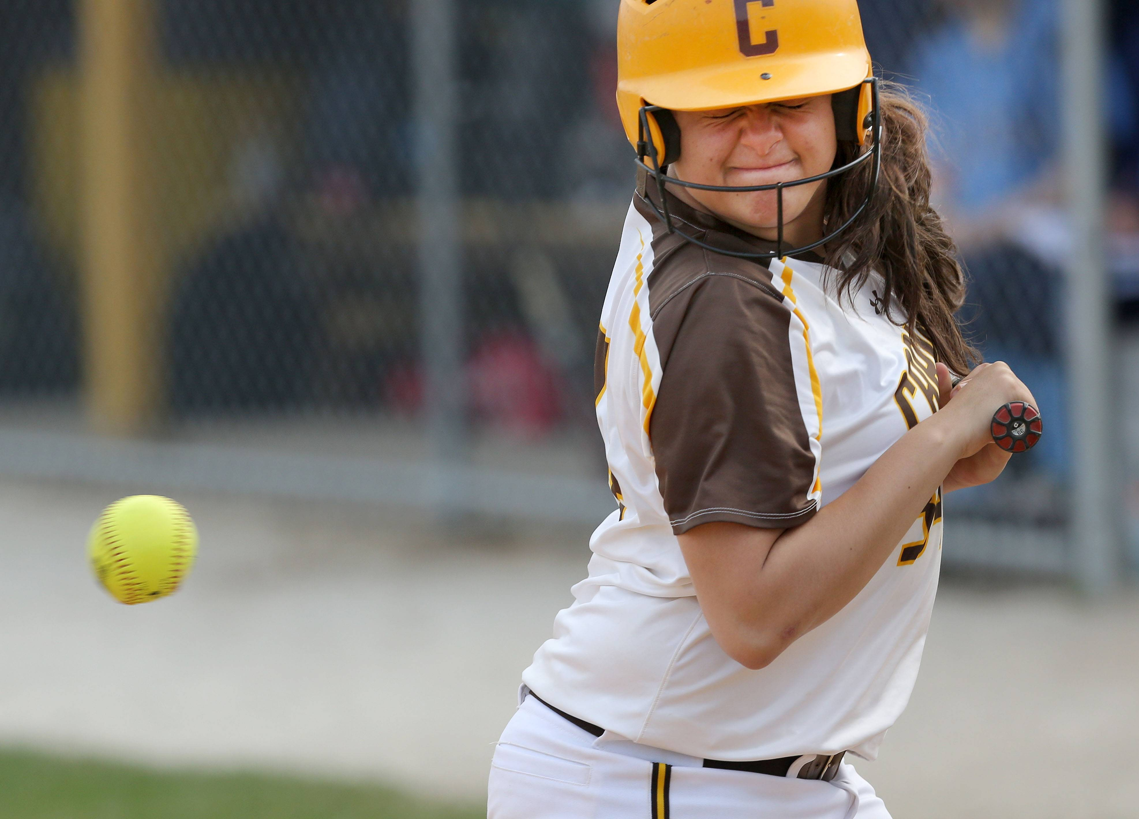 Carmel Catholic's Dani DeLozier gets hit by a pitch against Nazareth on Wednesday at Carmel.