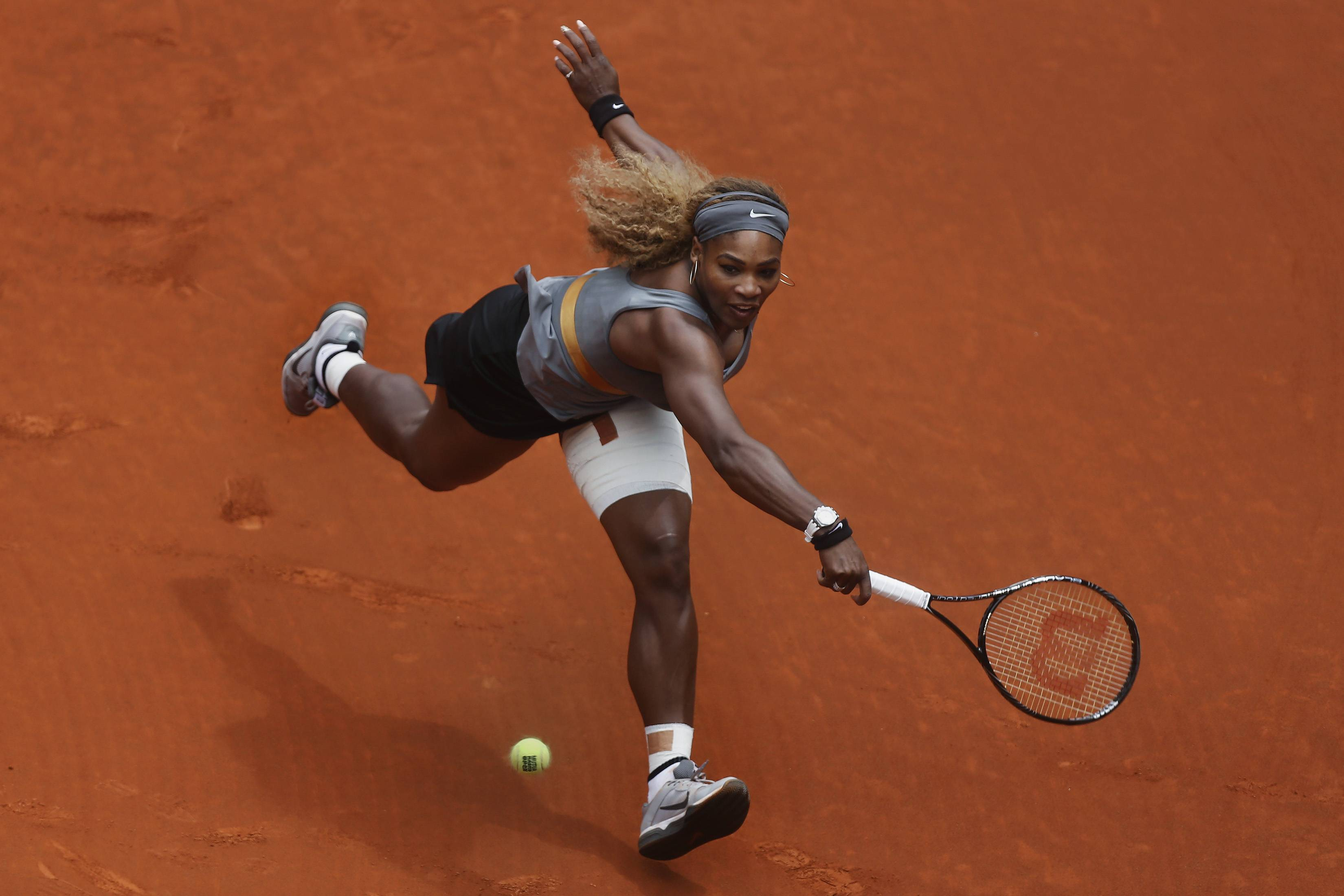 Serena Williams from U.S. returns the ball during a Madrid Open tennis tournament match against Shuai Peng from China, in Madrid, Spain, Wednesday, May 7, 2014.