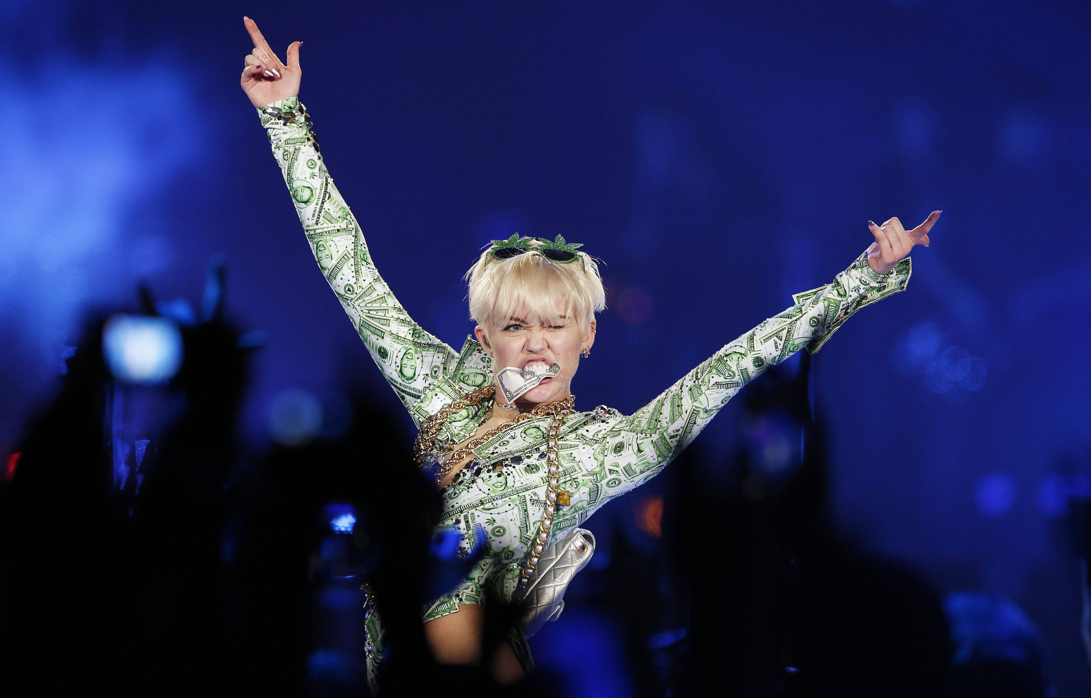 "Miley Cyrus returned to the stage Tuesday for the U.K. leg of her ""Bangerz"" tour at the O2 Arena in London."