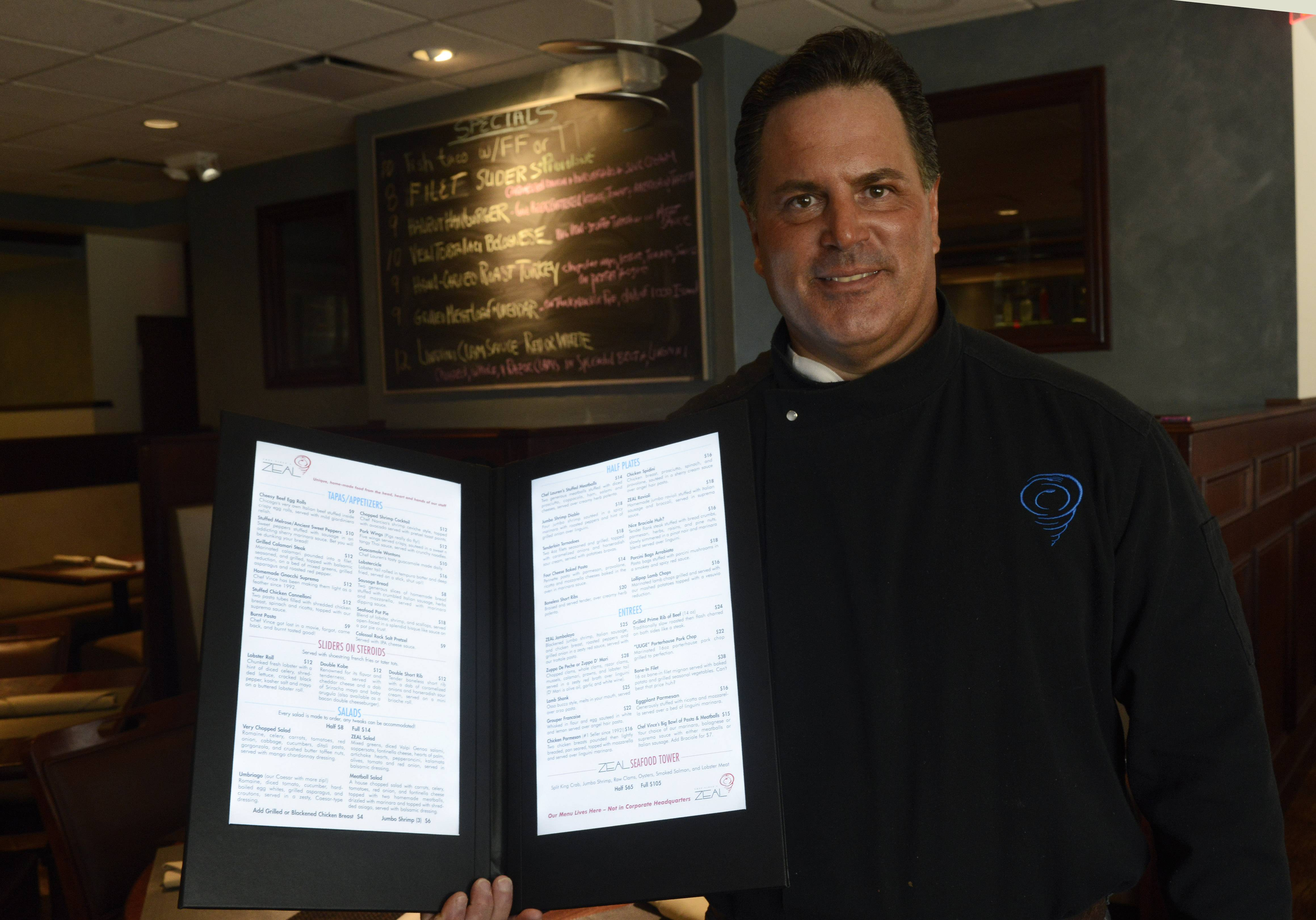 Chef Vince Pecora demonstrates the illuminated menu at Zeal in Schaumburg.