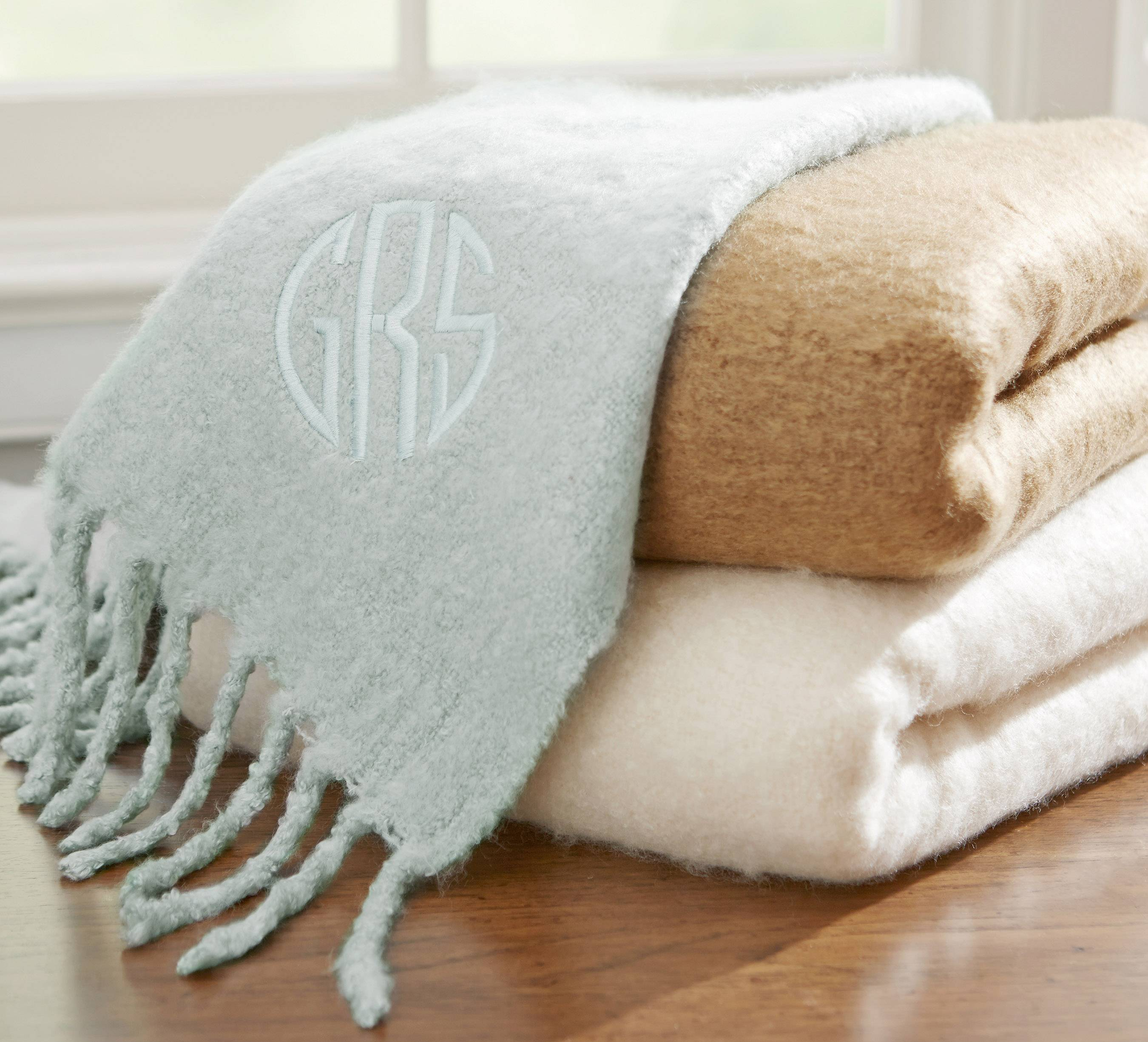 A faux mohair throw with initials might make a perfect gift for Mom.