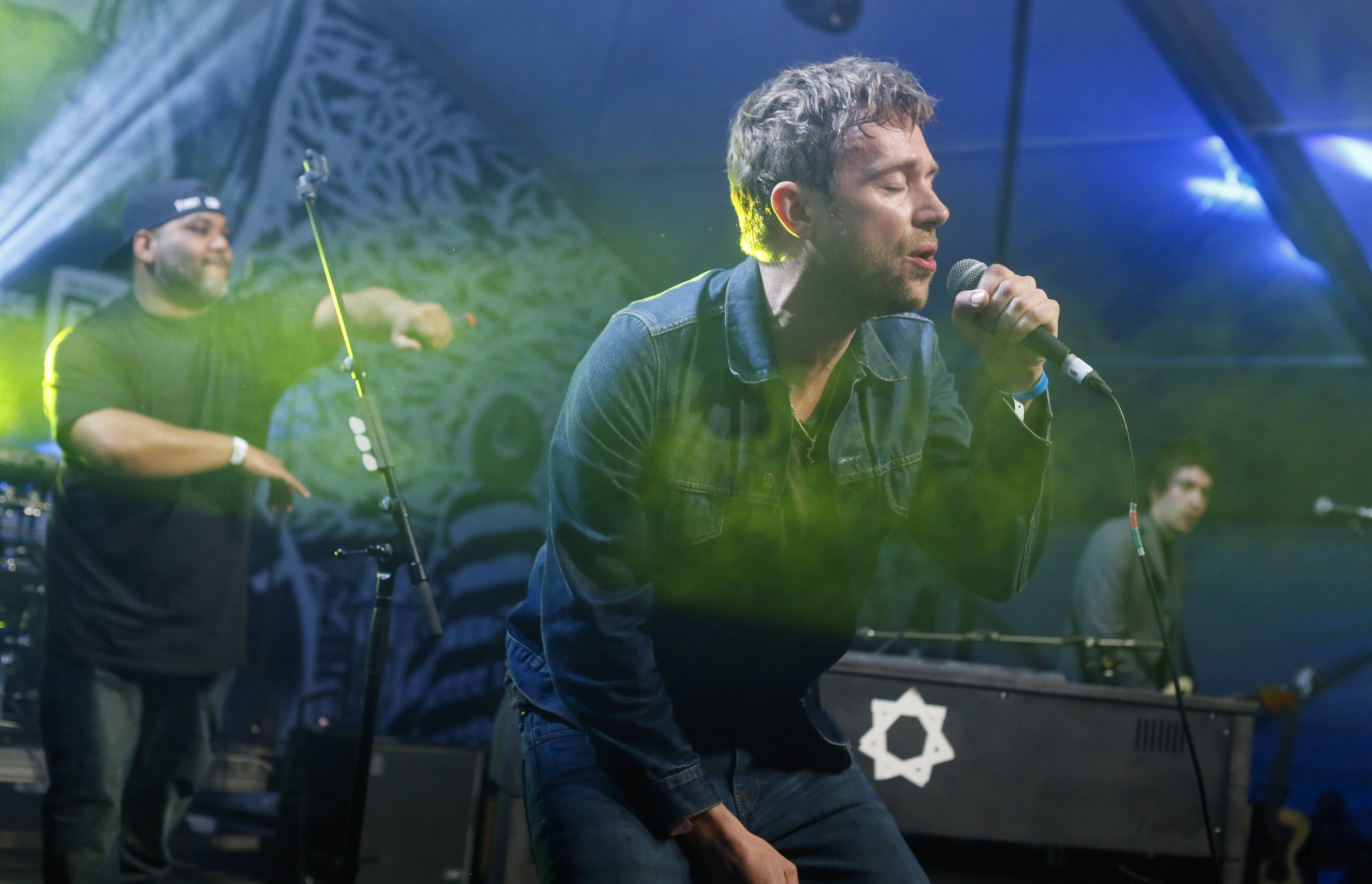 "Damon Albarn, right, was joined by De La Soul's Vincent Mason performing during the SXSW Music Festival in March in Austin, Texas. Albarn's new album, ""Everyday Robots,"" was released last week."