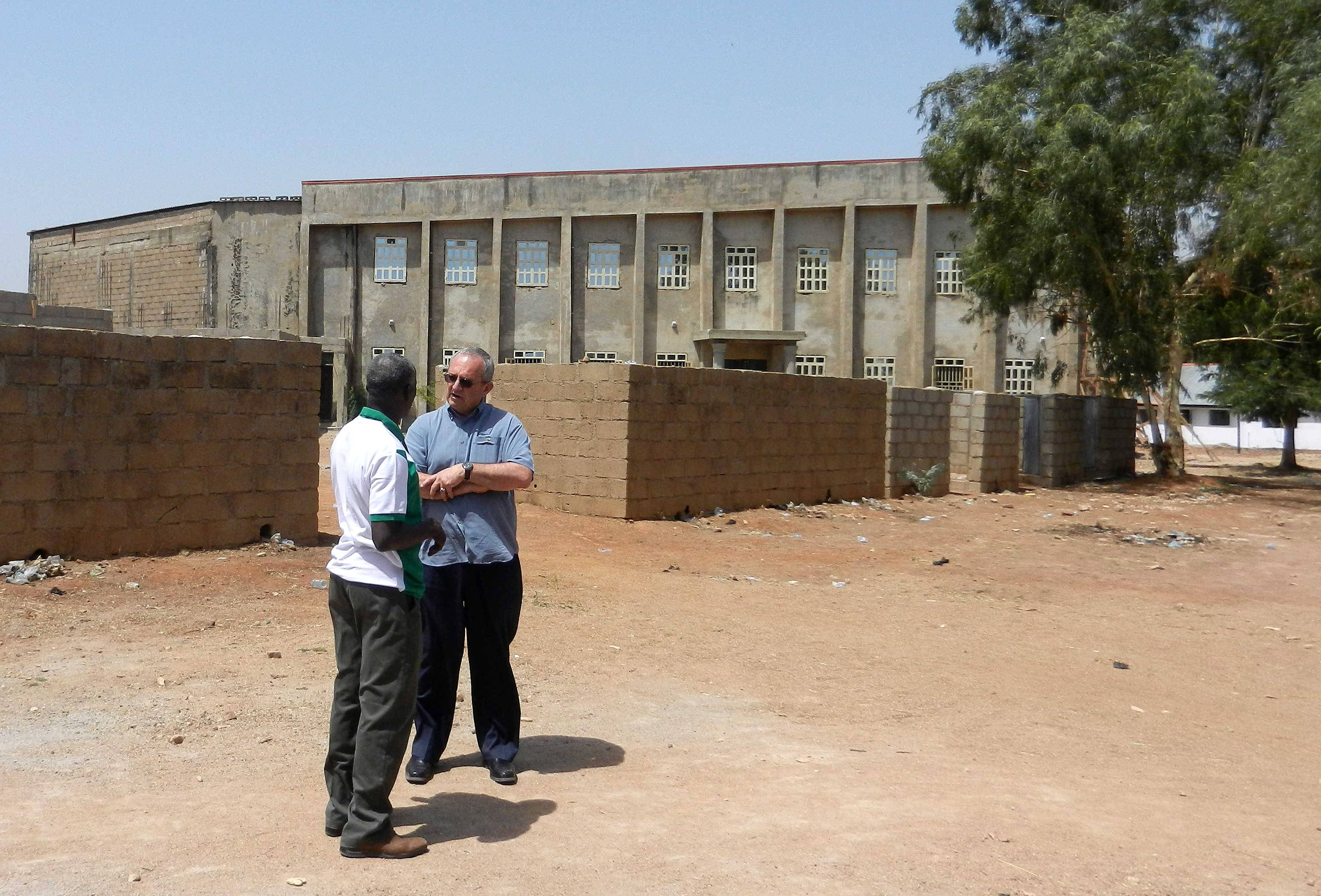Stanley Noffsinger, right, general secretary for the Church of the Brethren, whose headquarters are in Elgin, went on a trip to Nigeria last month. Here he is pictured the week of April 7 with Ekklesiyar Yan'uwa a Nigeria's president, Samuel Dali, in front of a new building being built in Kwarhi, Nigeria, by EYN, which is a sister church to Church of the Brethren.