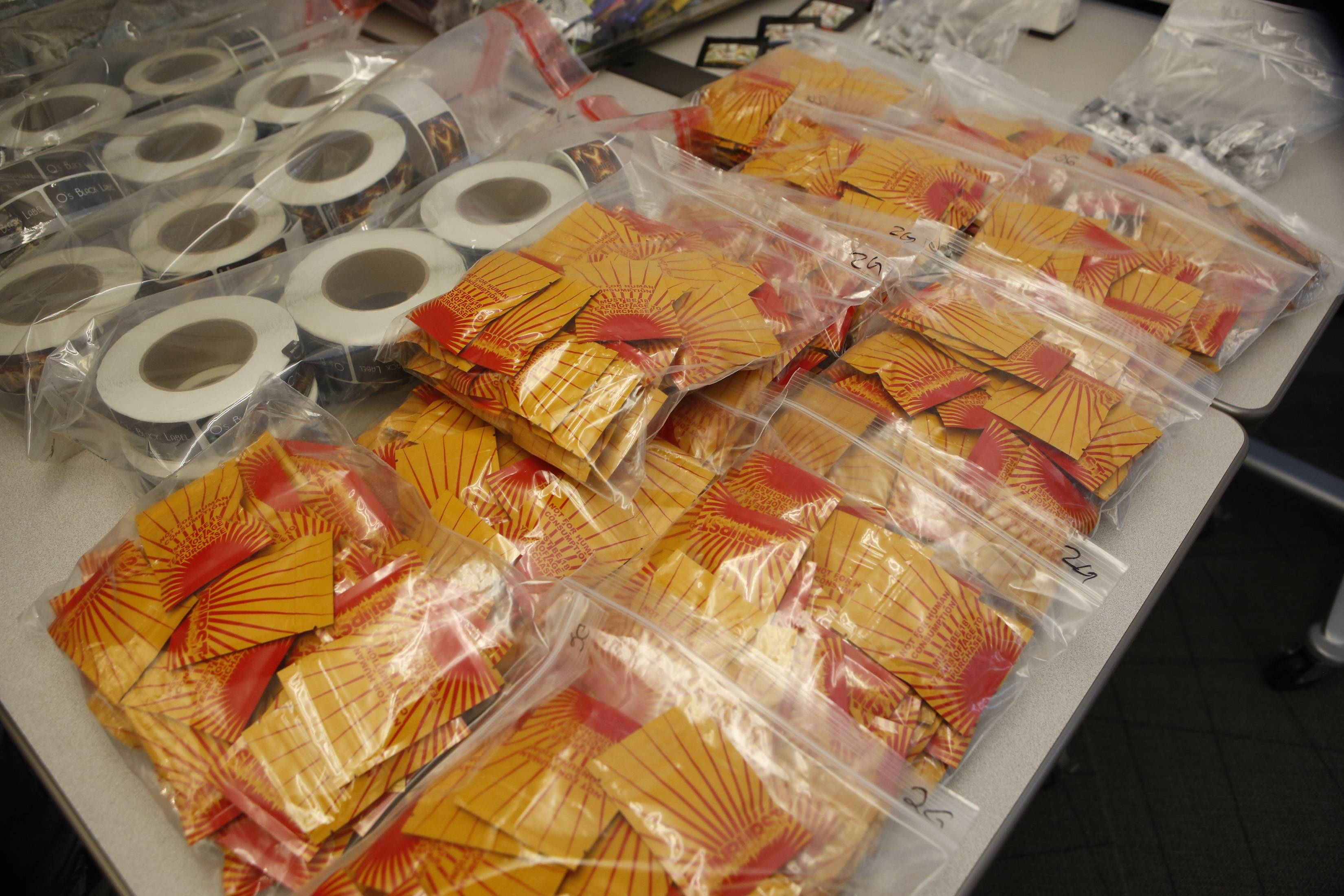 "Confiscated synthetic drugs are on display at a news conference at the DEA offices in Centennial, Colo., Wednesday, where it was announced that a federal grand jury in Denver has returned indictments charging nine individuals from across the country with conspiracy and drug distribution charges related to ""Spice."""