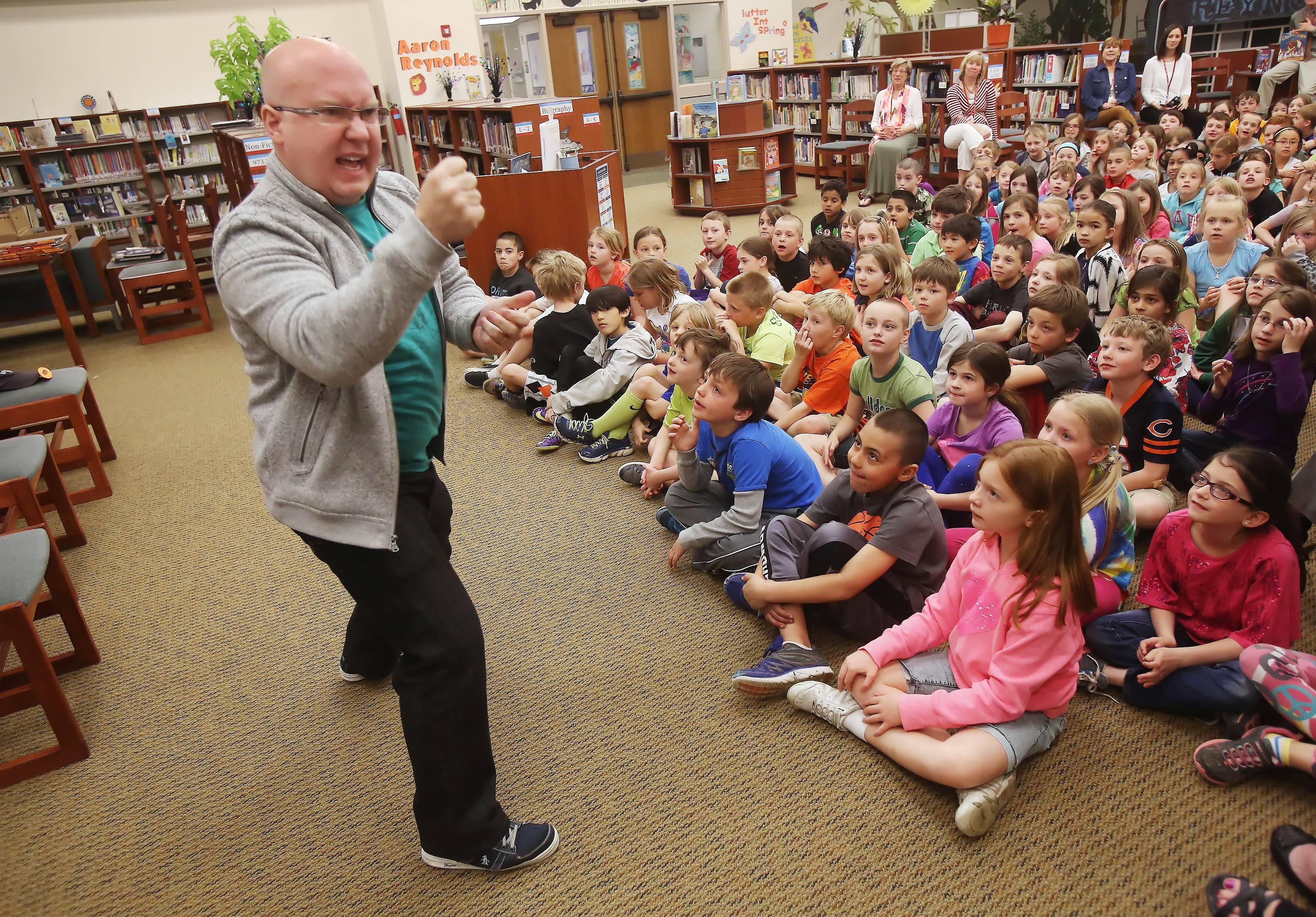 Children's author Aaron Reynolds educates and entertains students Wednesday at Butterfield Elementary School in Libertyville. Reynolds has been on The New York Times best-seller list and won the Caldecott Medal award.