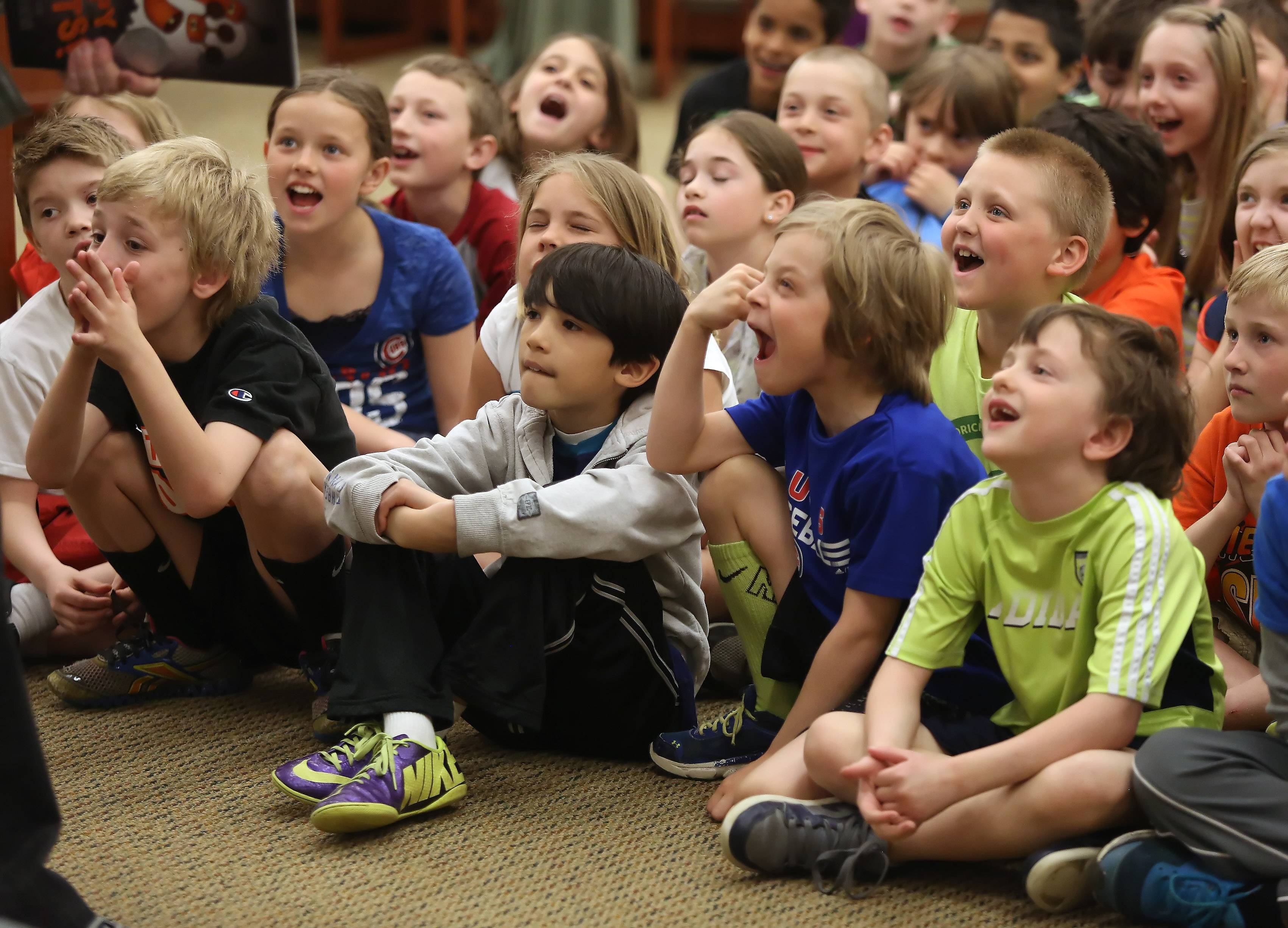 Students laugh at children's author Aaron Reynolds as he entertained them Wednesday at Butterfield Elementary School in Libertyville. Reynolds has been on The New York Times best-seller list and won the Caldecott Medal award.