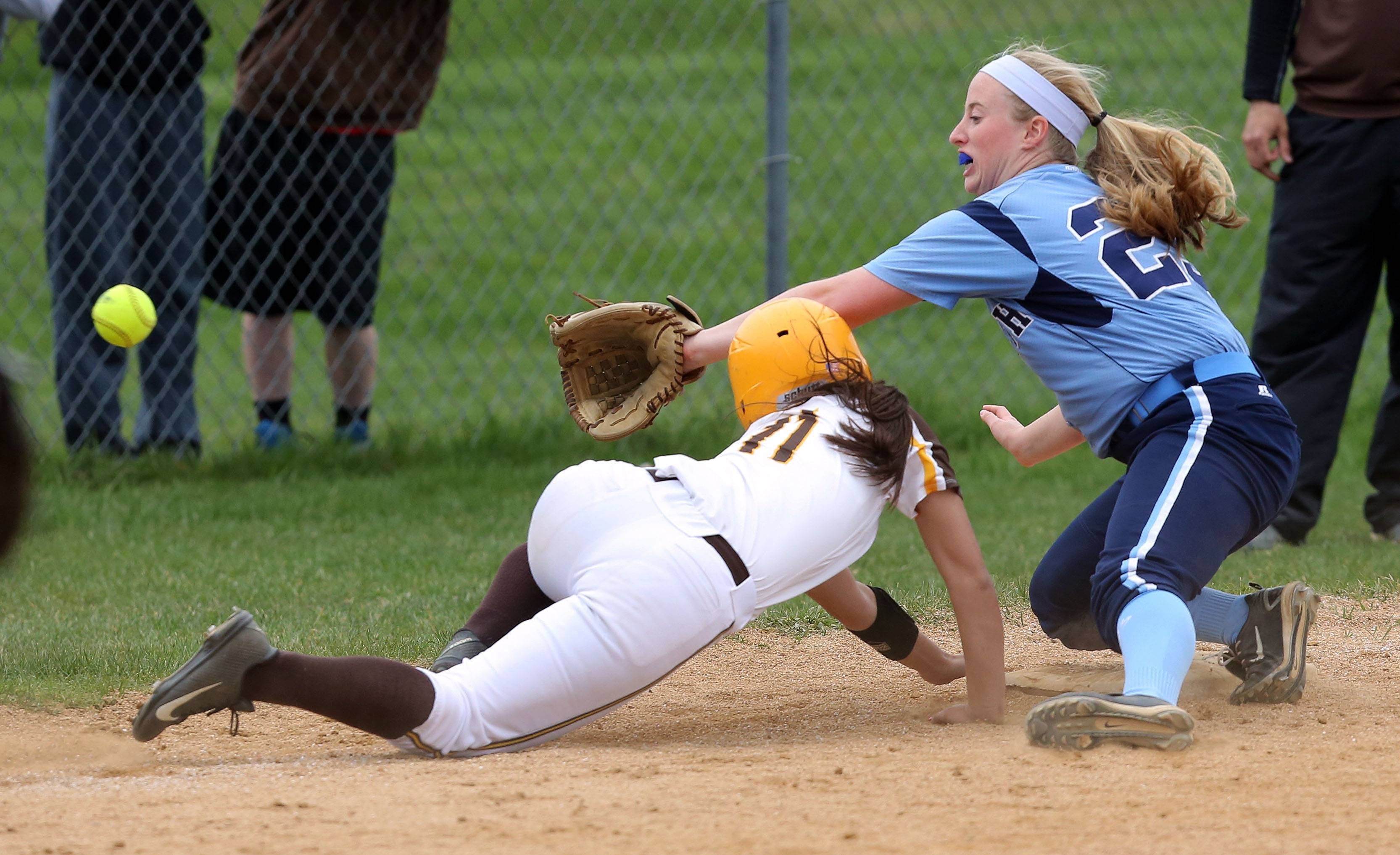 Carmel's Anne Poll dives back safely to third as Nazareth's Colleen McGivney makes the play Wednesday in Mundelein.