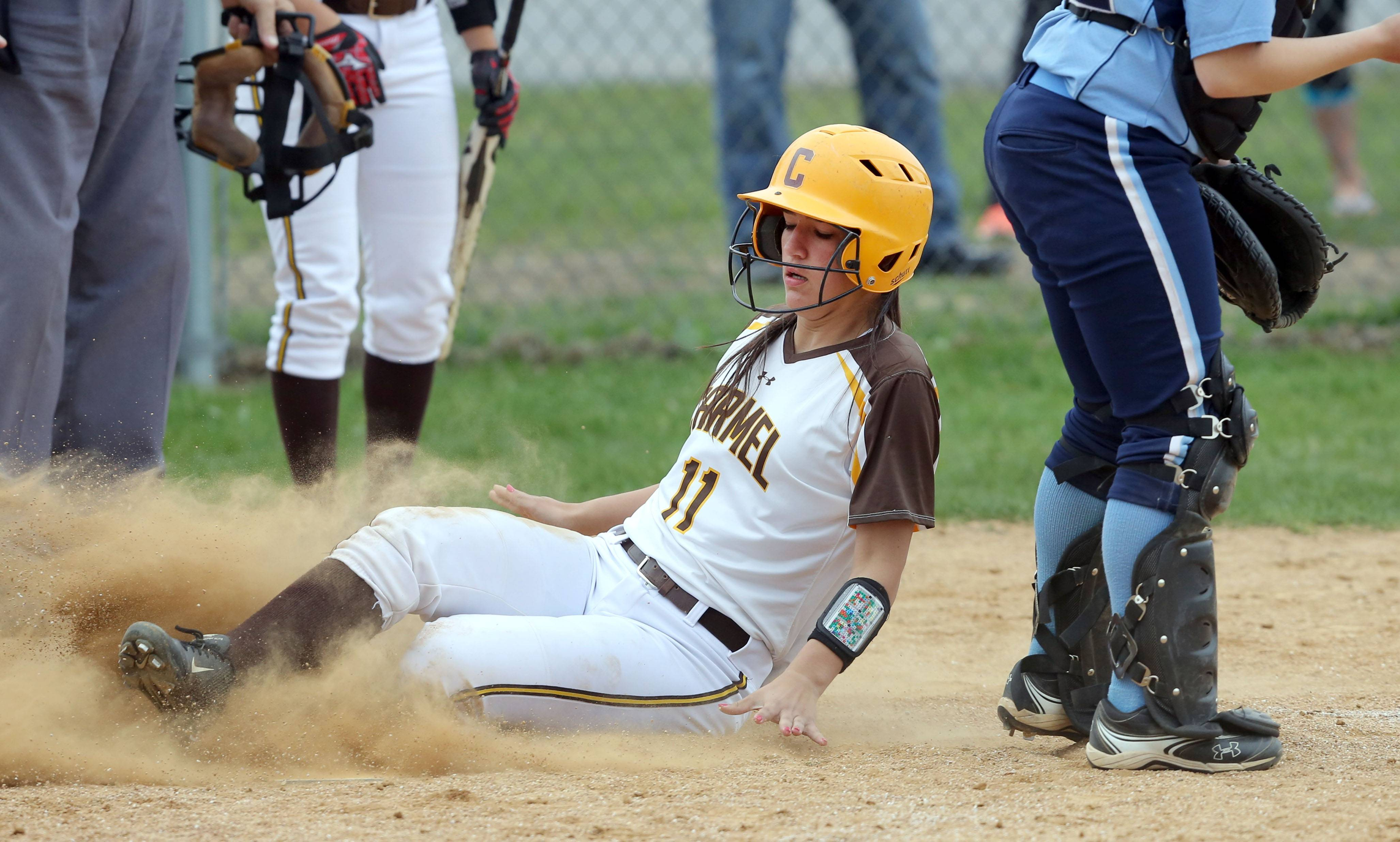 Carmel's Anne Poll scores against Nazareth on Wednesday in Mundelein.