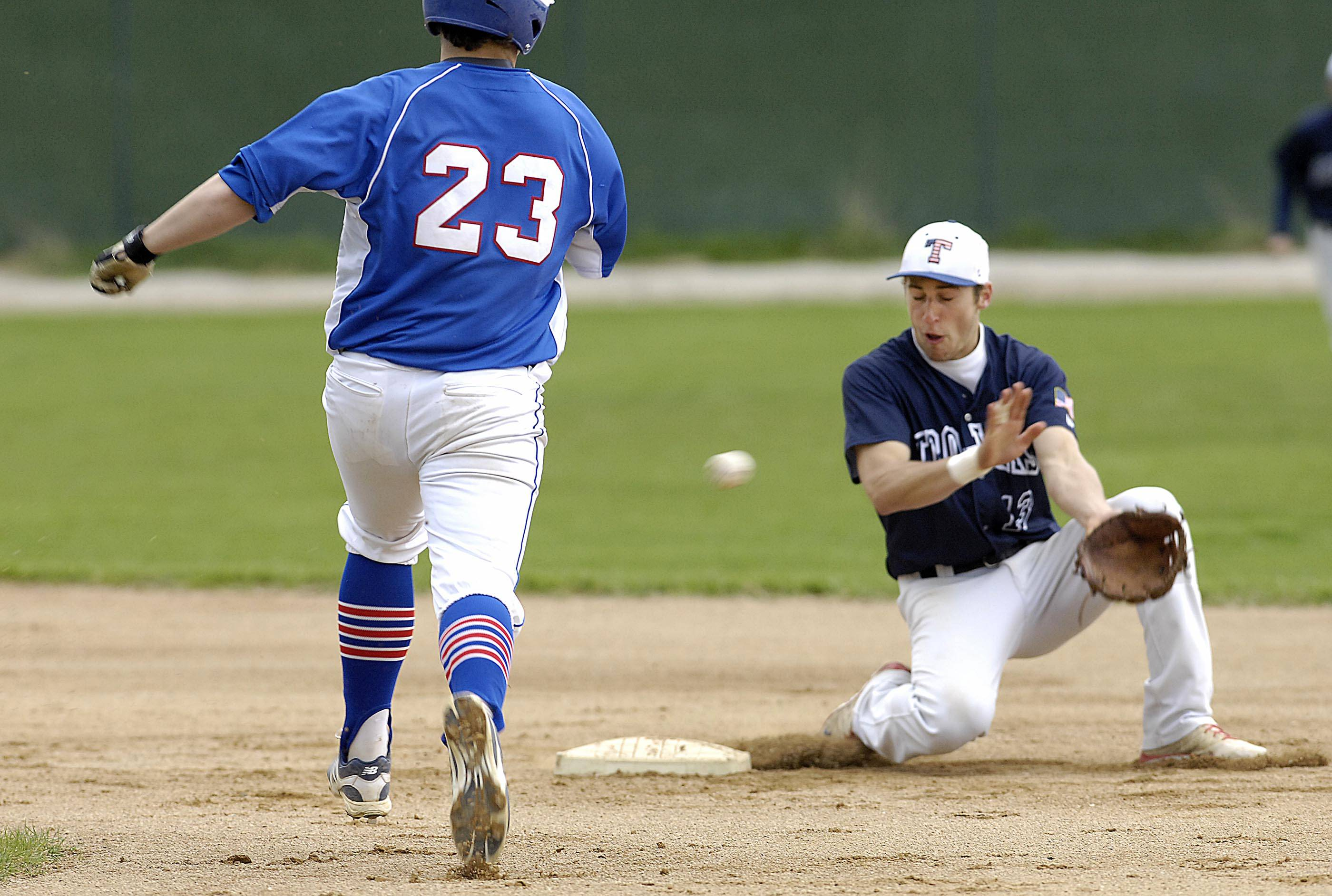 Dundee-Crown's Riley Alvarado hustles into second as the throw reaches Cary-Grove's Dean Christakes Wednesday in Cary. Alvarado was safe with the steal in the first inning.