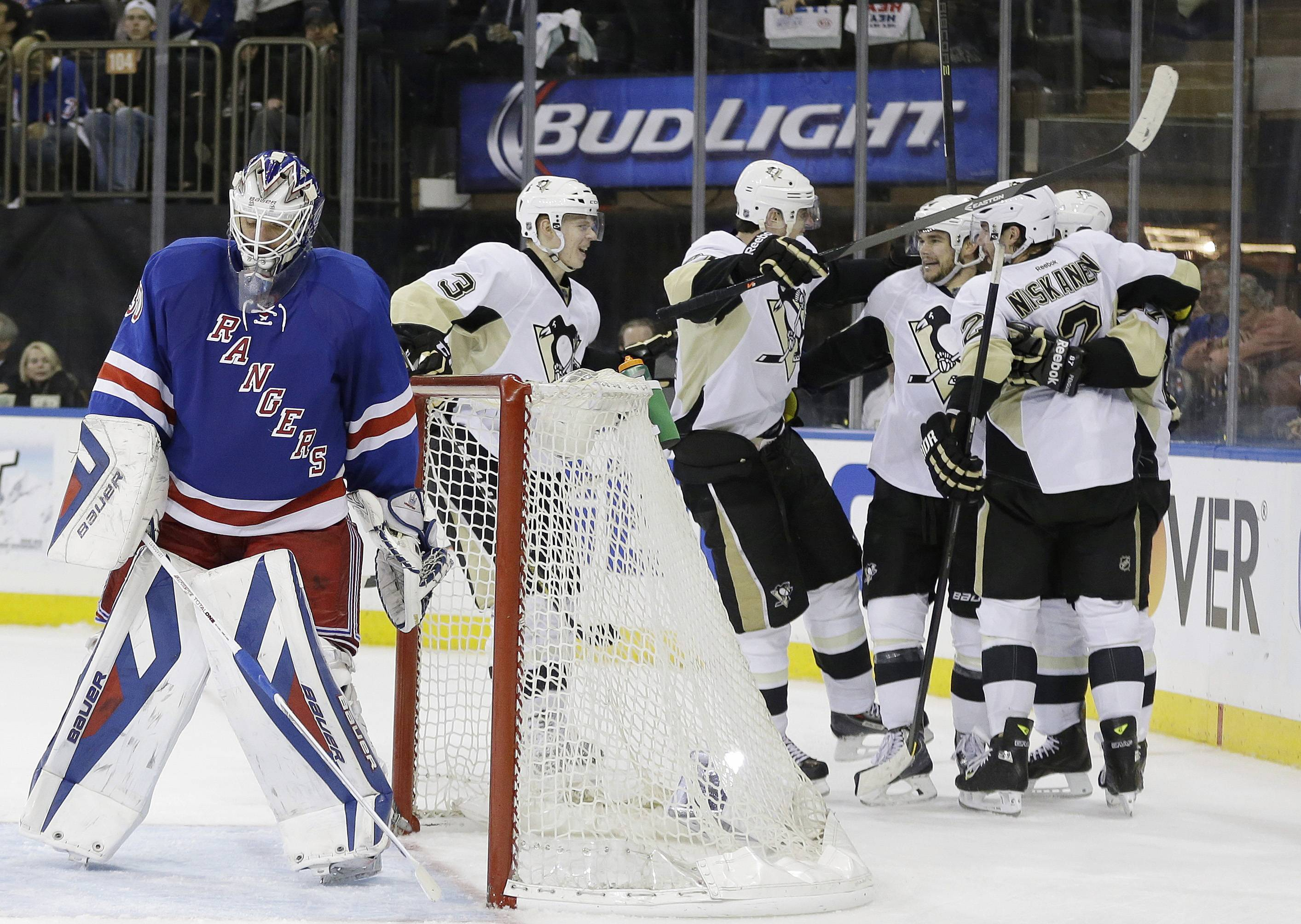 New York Rangers goalie Henrik Lundqvist, left, of Sweden, reacts as the Pittsburgh Penguins celebrate a goal by Chris Kunitz during the third period of a second-round NHL Stanley Cup hockey playoff series Wednesday, May 7, 2014, in New York. The Penguins won 4-2.