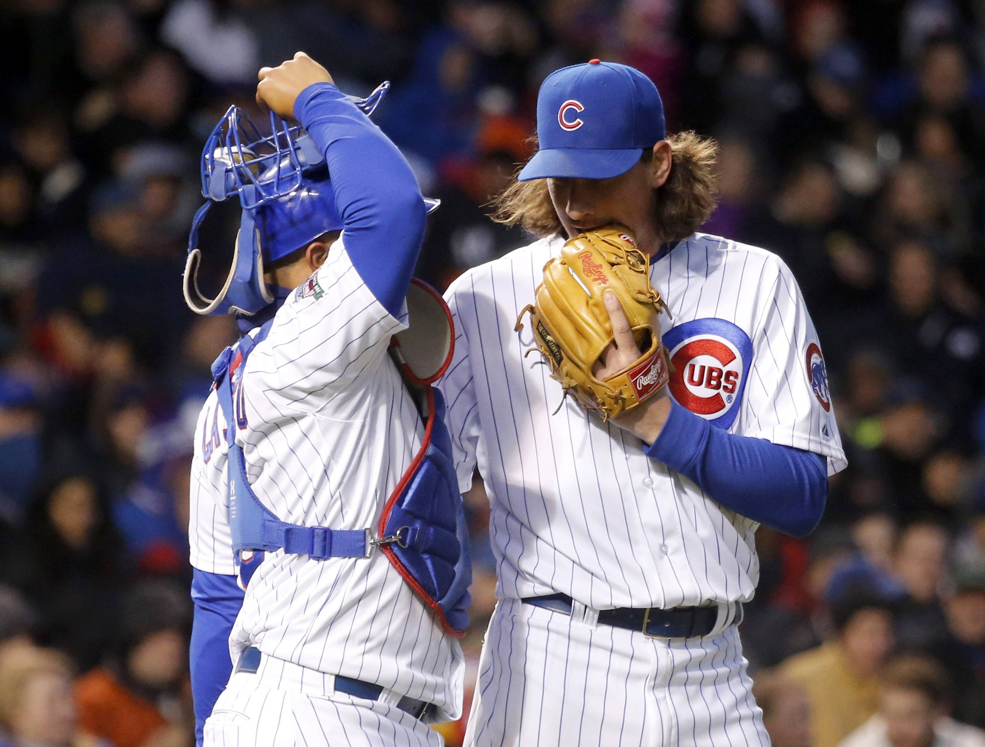 Chicago Cubs starting pitcher Jeff Samardzija, right, talks to catcher Welington Castillo during the fourth inning of an interleague baseball game against the Chicago White Sox Monday, May 5, 2014, in Chicago.