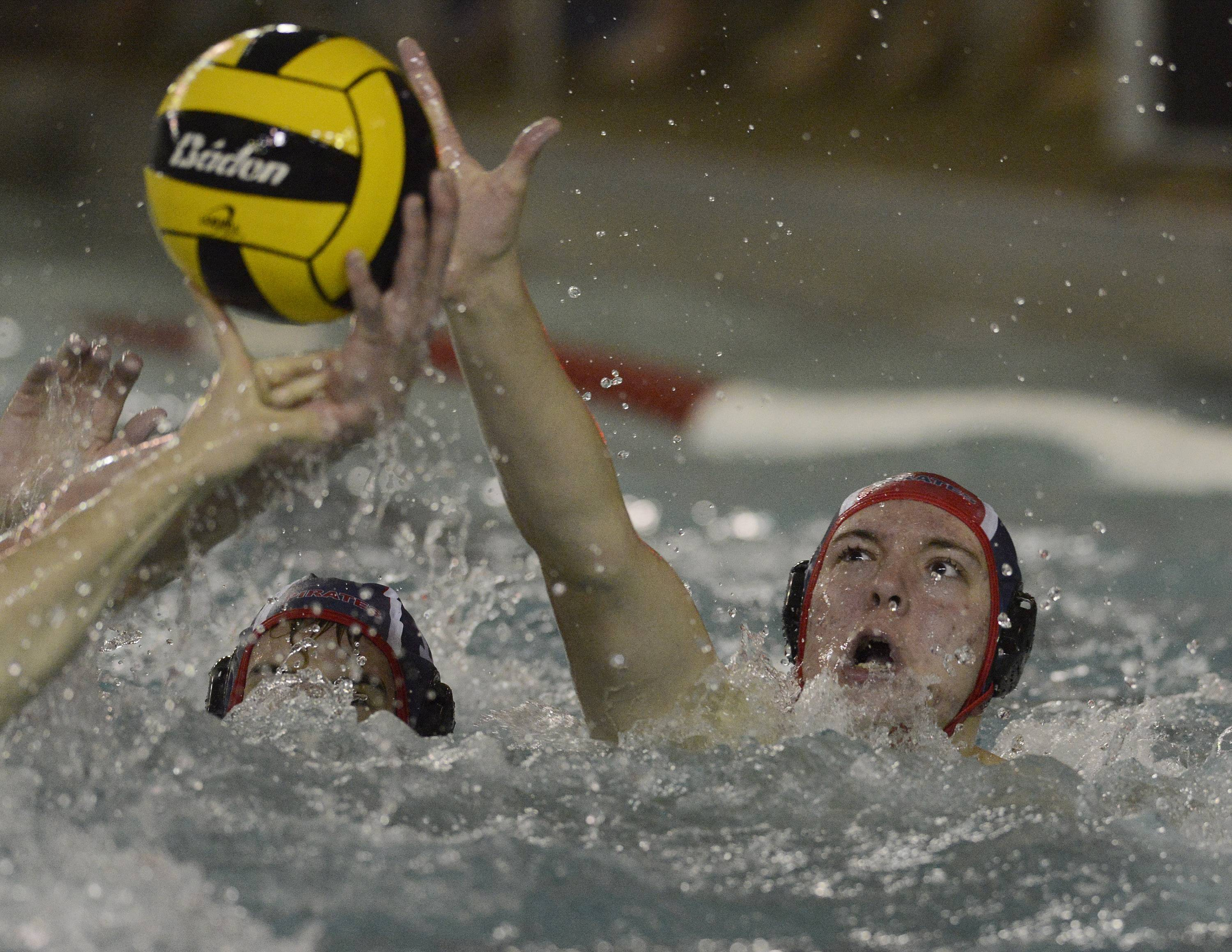 Palatine goalie Colin White knocks the ball from the hand of a Hersey player during Wednesday's match.