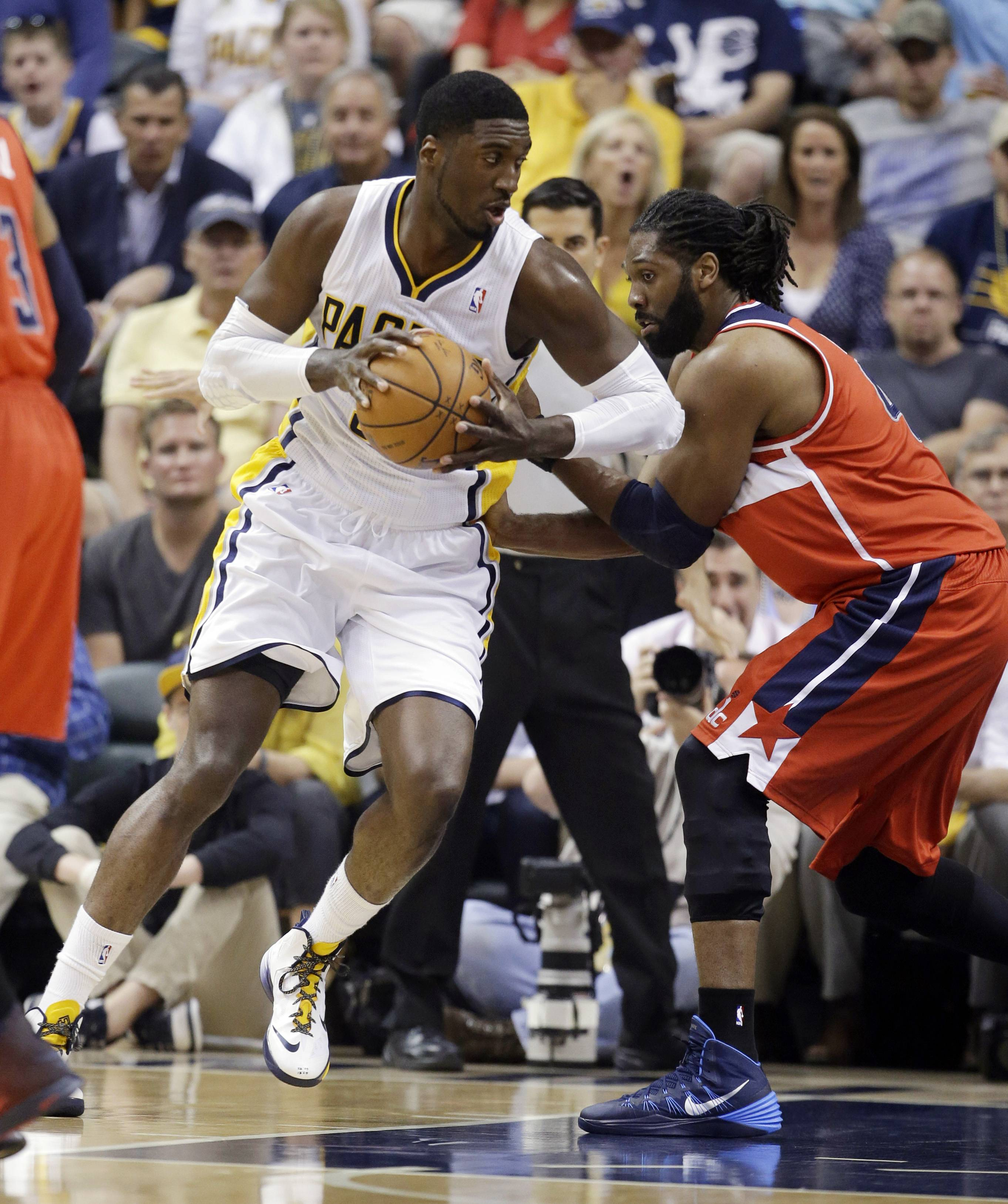 Indiana Pacers center Roy Hibbert, left, drives on Washington Wizards forward Nene Hilario during the first half of game 2 of the Eastern Conference semifinal NBA basketball playoff series Wednesday, May 7, 2014, in Indianapolis.