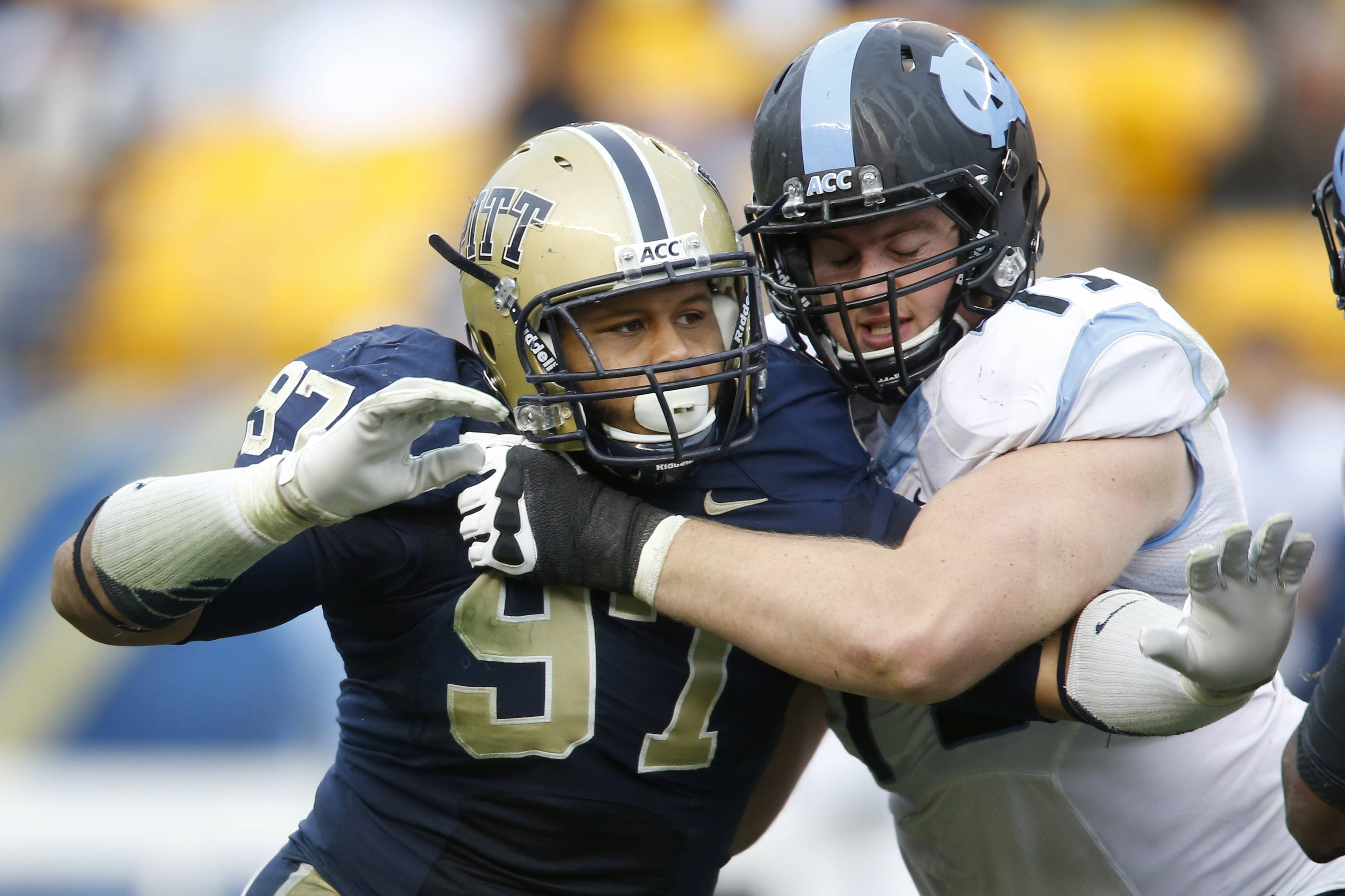 Pittsburgh defensive lineman Aaron Donald, left, could be the Panthers' highest draft pick since wideout Larry Fitzgerald was taken third overall by the Arizona Cardinals in 2004. He had an NCAA-best 28½ tackles for loss last season.