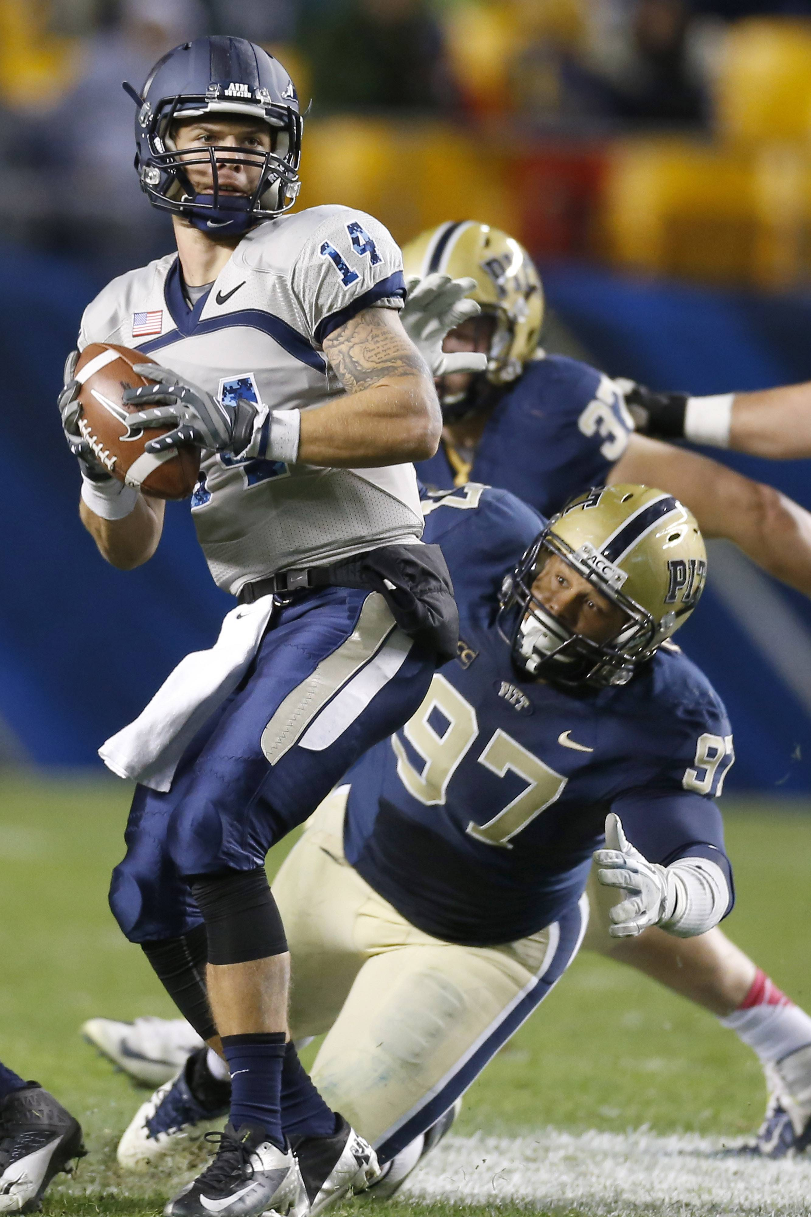 In this Oct. 19, 2013, file photo, Pittsburgh defensive lineman Aaron Donald (97) pressures Old Dominion quarterback Taylor Heinicke (14) during an NCAA football game in Pittsburgh. Donald, the most-decorated defensive player during the 2013 college football season with four major awards, could be the Panthers' highest draft pick since wideout Larry Fitzgerald was taken third overall by the Arizona Cardinals in 2004.