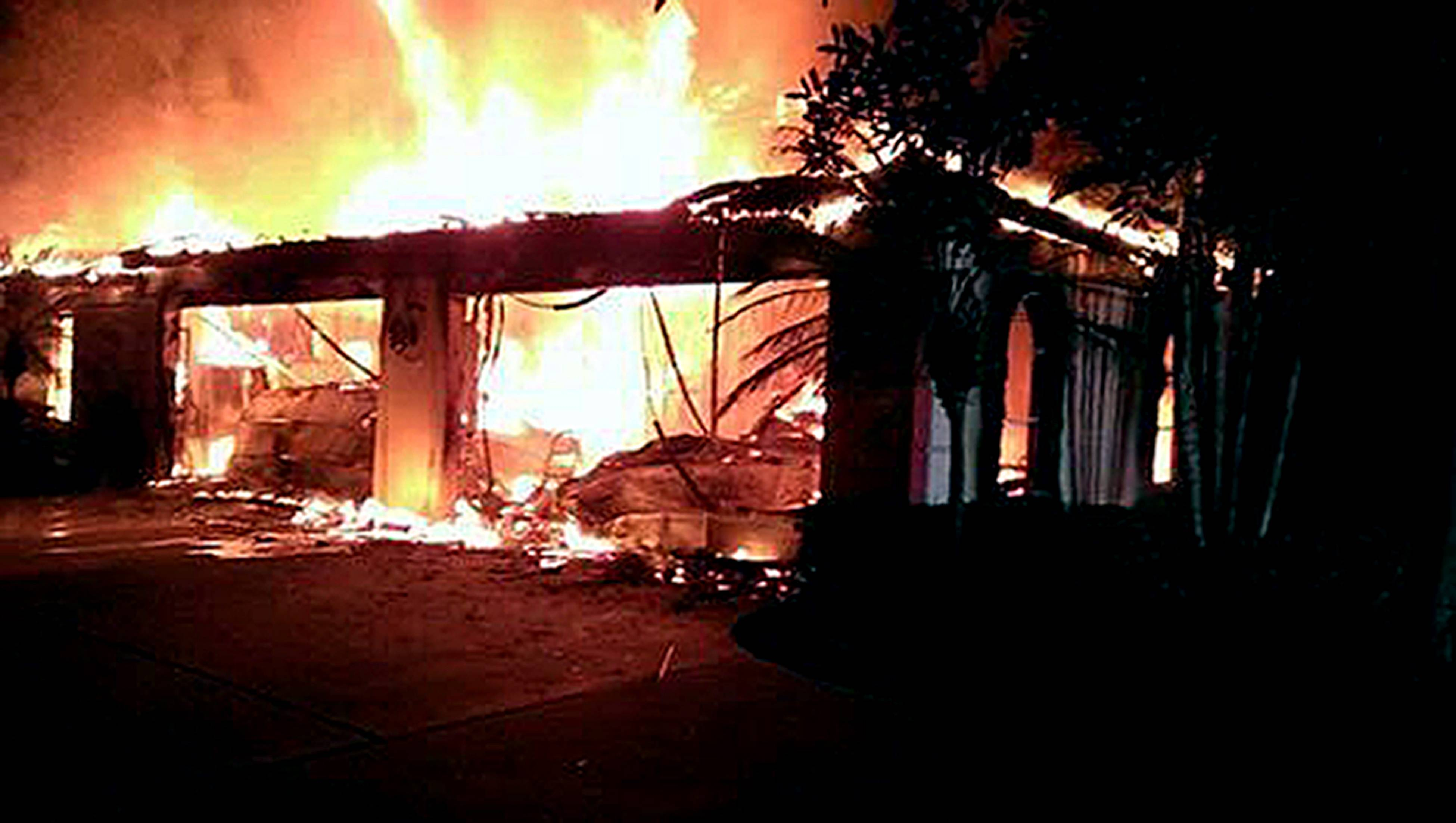 In this photo provided by the Hillsborough County Sheriff's Office, flames destroy a home in a gated community Wednesday May 7, 2014 in Tampa, Fla. Officials have confirmed that three bodies have been found in the home.
