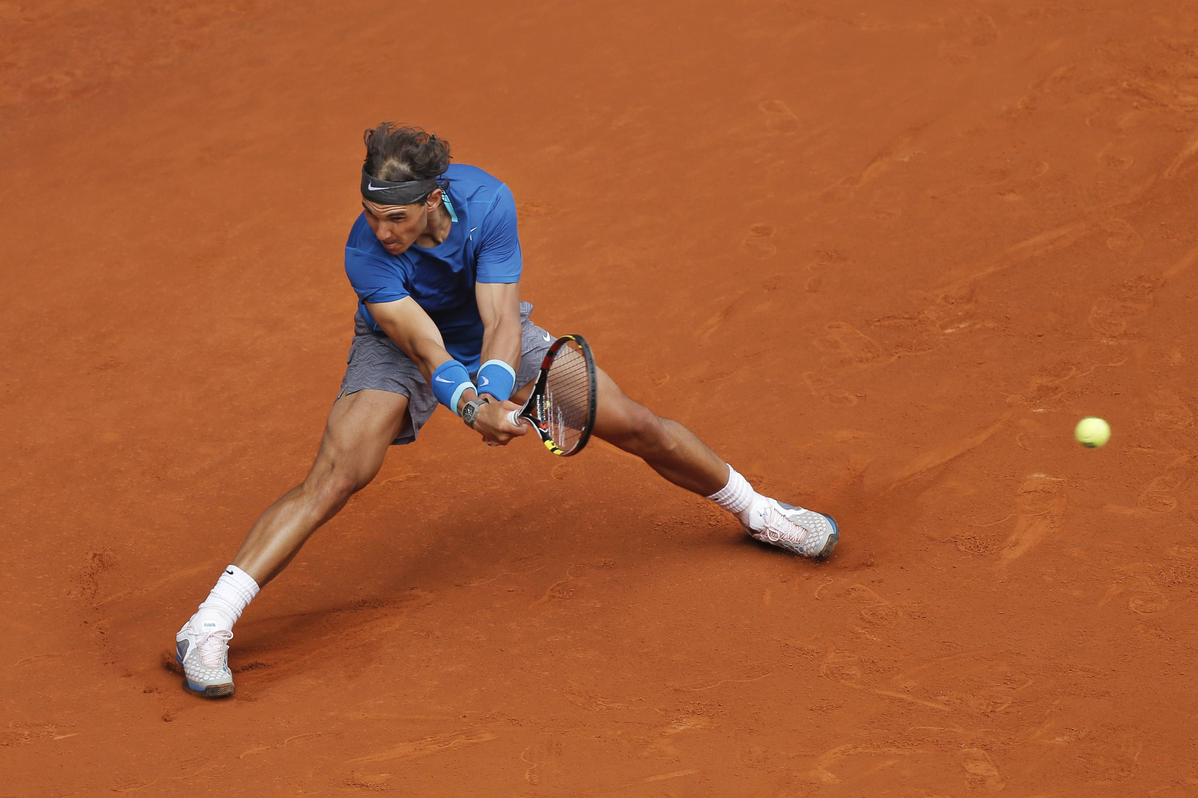 Rafael Nadal from Spain returns a ball during a Madrid Open tennis tournament match against Juan Monaco from Argentina, in Madrid, Spain, Wednesday, May 7, 2014.