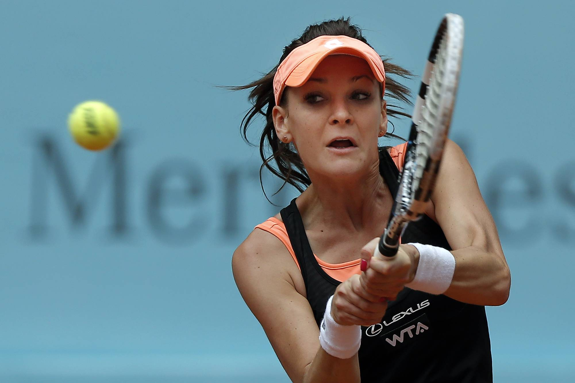 Agnieszka Radwanska from Poland returns the ball during a Madrid Open tennis tournament match against Svetlana Kuznetsova from Russia, in Madrid, Spain, Wednesday, May 7, 2014.