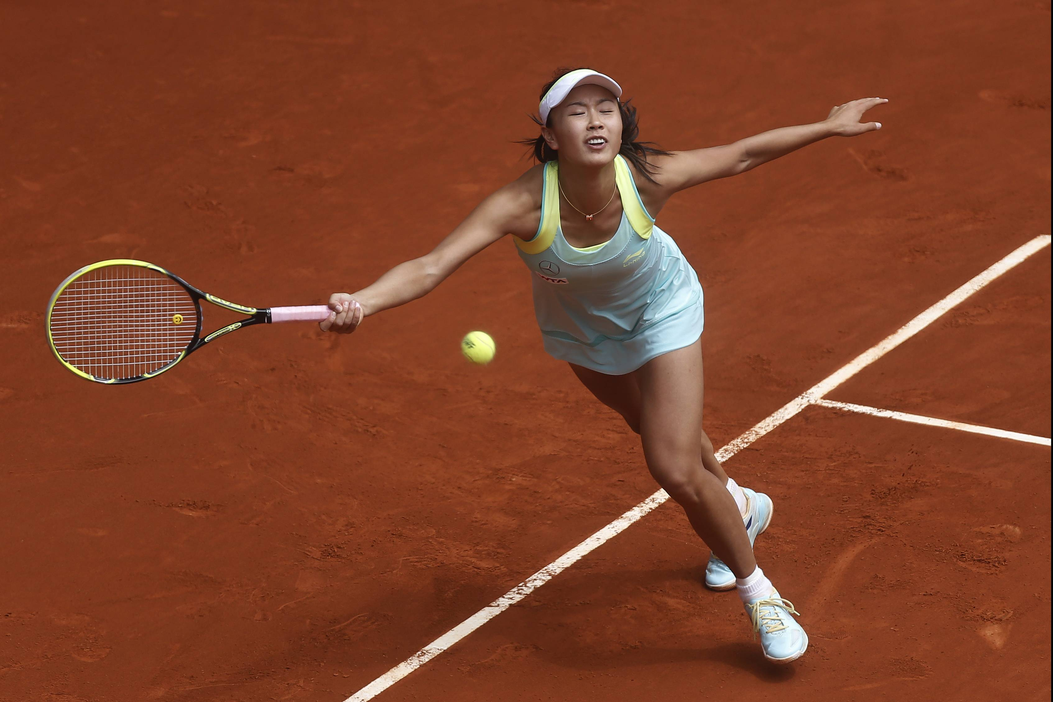 Shuai Peng from China fails to return the ball during a Madrid Open tennis tournament match against Serena Williams from US, in Madrid, Spain, Wednesday, May 7, 2014.