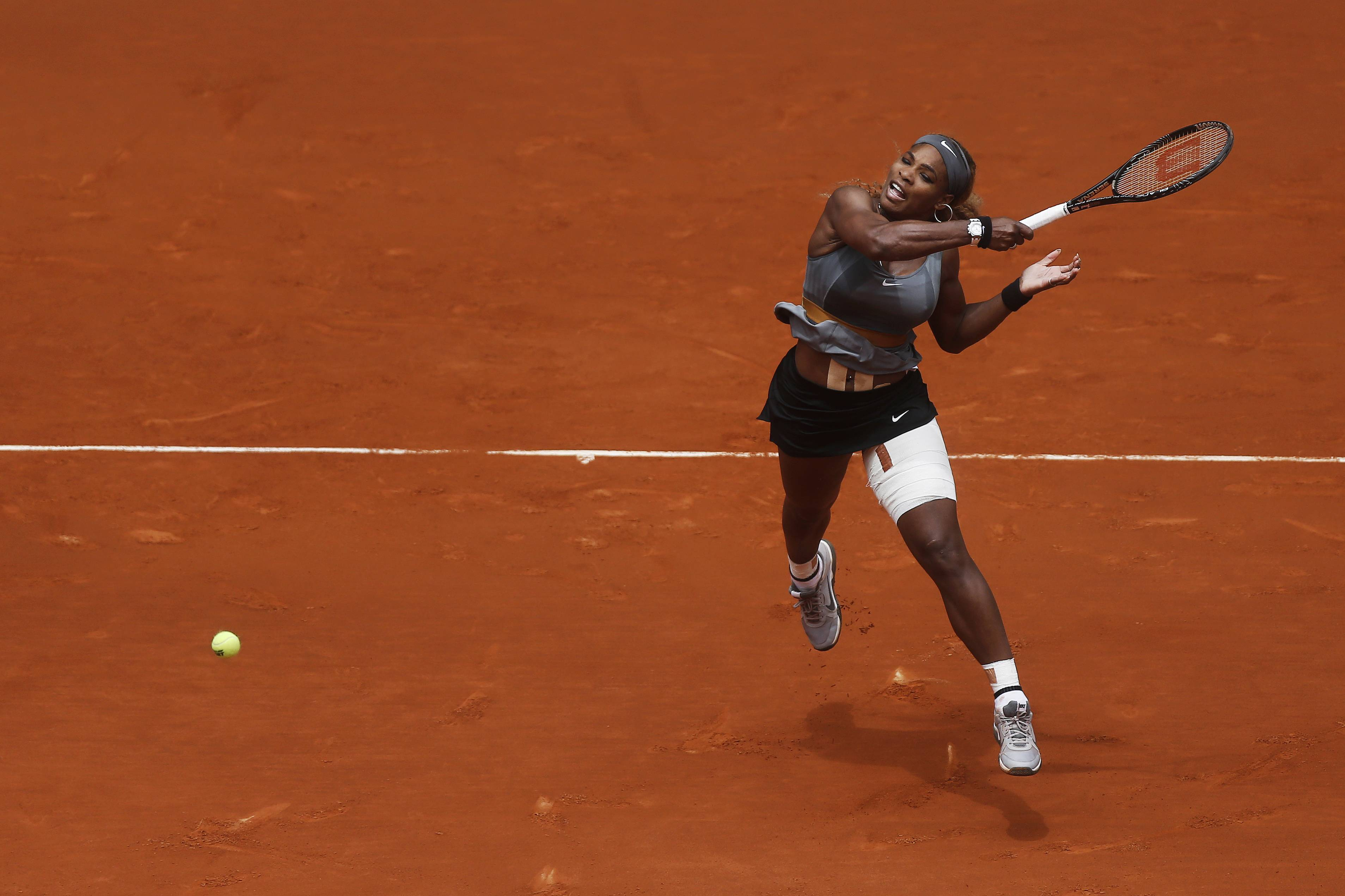 Serena Williams from US returns the ball to Shuai Peng from China during a Madrid Open tennis tournament match in Madrid, Spain, Wednesday, May 7, 2014.