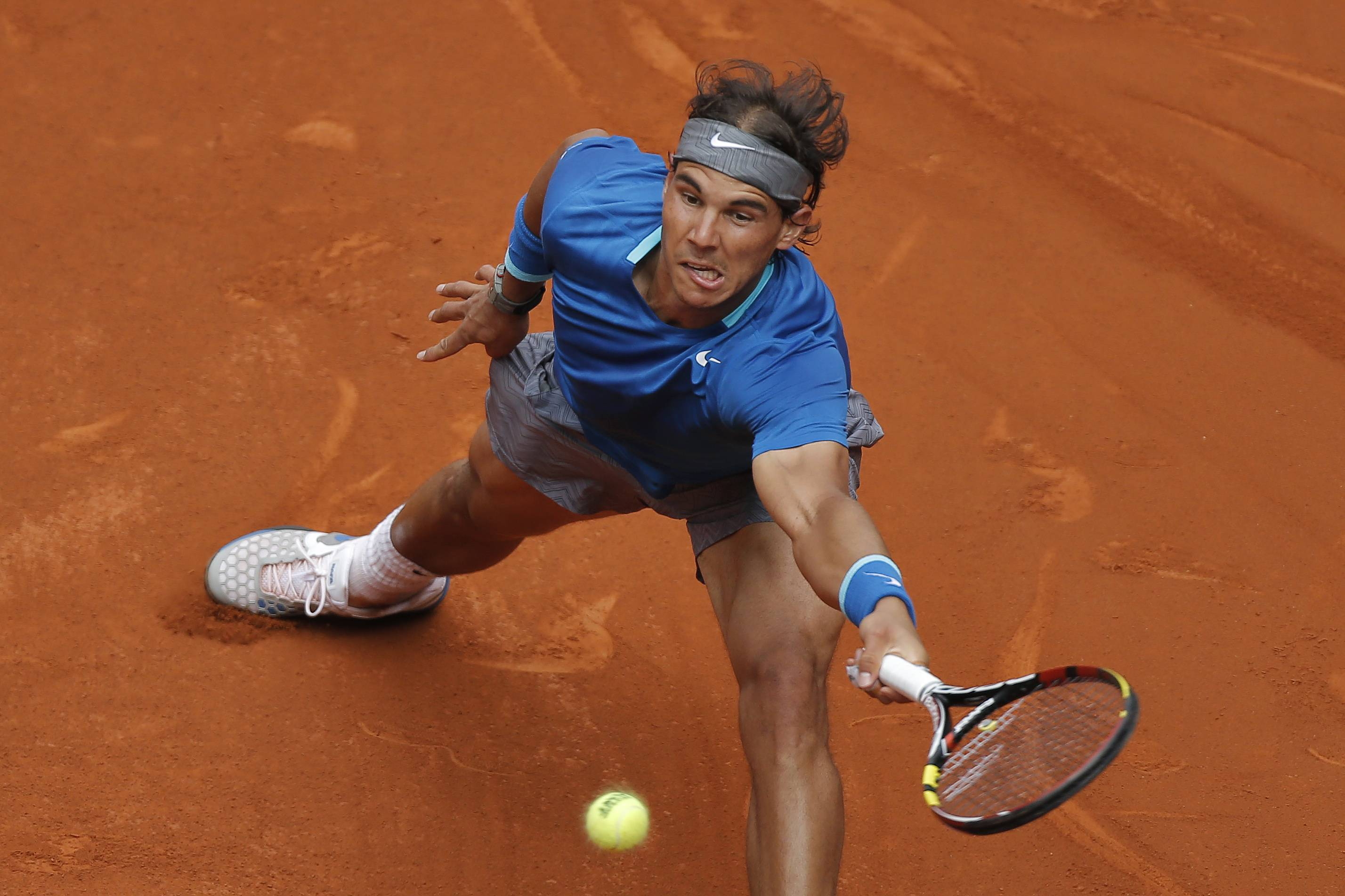 Rafael Nadal from Spain returns the ball during a Madrid Open tennis tournament match against Juan Monaco from Argentina, in Madrid, Spain, Wednesday, May 7, 2014.